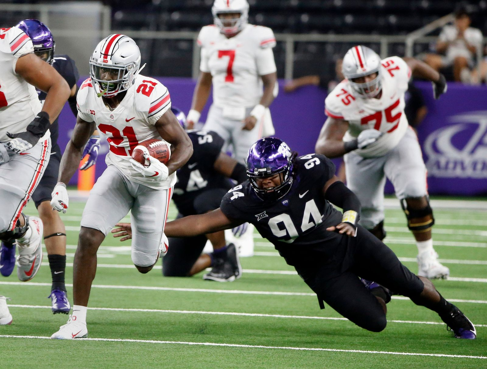 Ohio State wide receiver Parris Campbell (21) runs for a touchdown as TCU defensive tackle Corey Bethley (94) fails on a tackle attempt during the second half of an NCAA college football game in Arlington, Texas, Saturday, Sept. 15, 2018. (AP Photo/Michael Ainsworth)