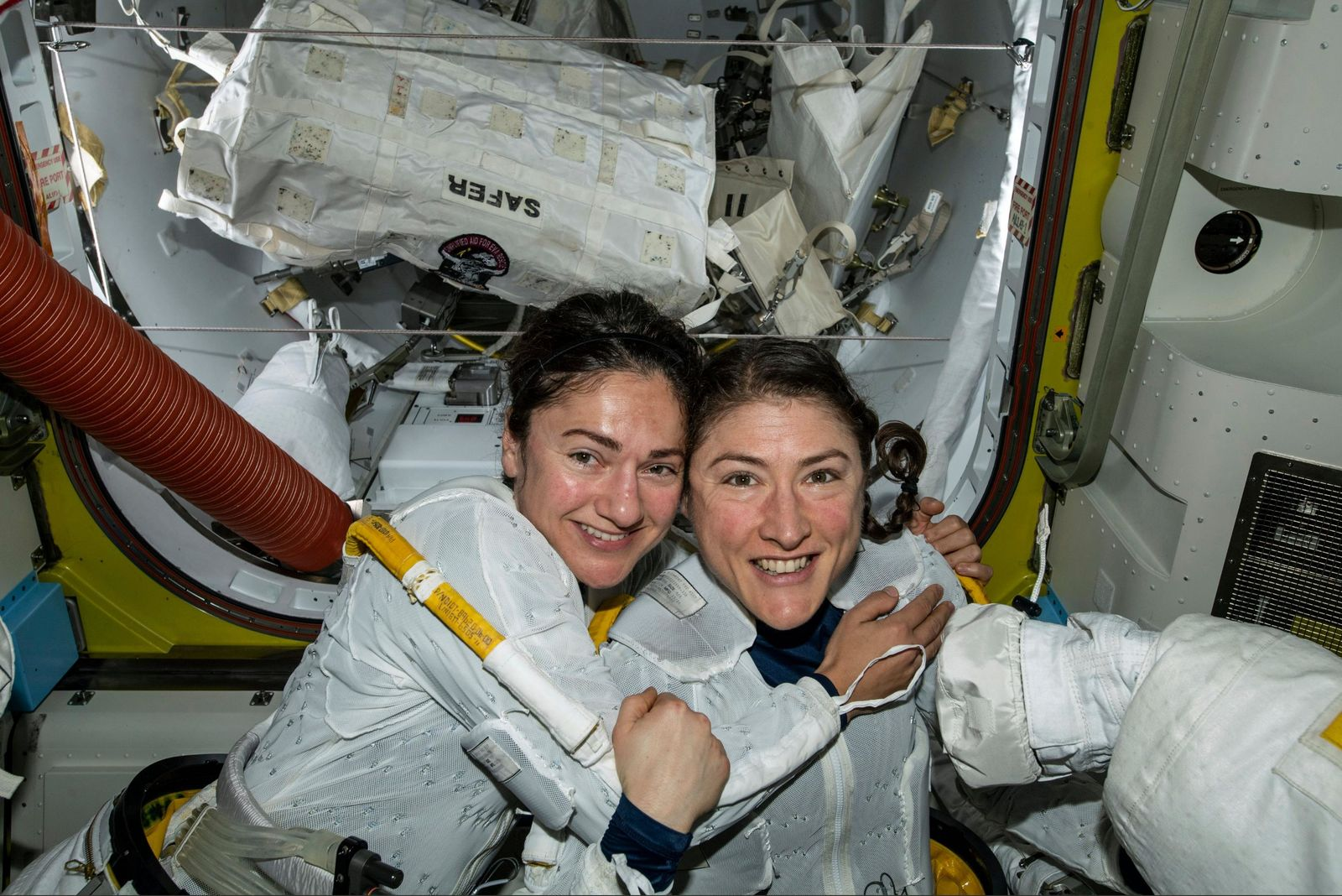 In this photo released by NASA on Friday, Oct. 18, 2019, U.S. astronauts Jessica Meir, left, and Christina Koch pose for a photo in the International Space Station. The astronauts who took part in the first all-female spacewalk are still uplifted by all the excitement down on Earth. Meir said Monday, Oct. 21 that when she floated outside last week, she wasn't thinking about whether she was going out with a man or woman because everyone is held to the same standard. Nonetheless, she says it was extra special being accompanied by Koch, a close friend.  (NASA via AP)