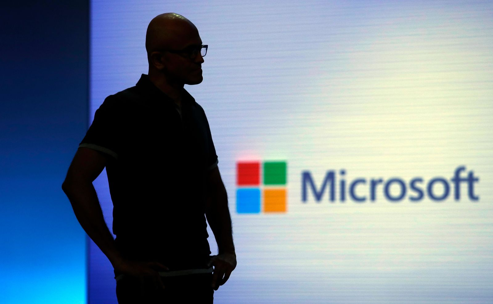 FILE- In this May 7, 2018, file photo Microsoft CEO Satya Nadella looks on during a video as he delivers the keynote address at Build, the company's annual conference for software developers in Seattle. (AP Photo/Elaine Thompson, File)