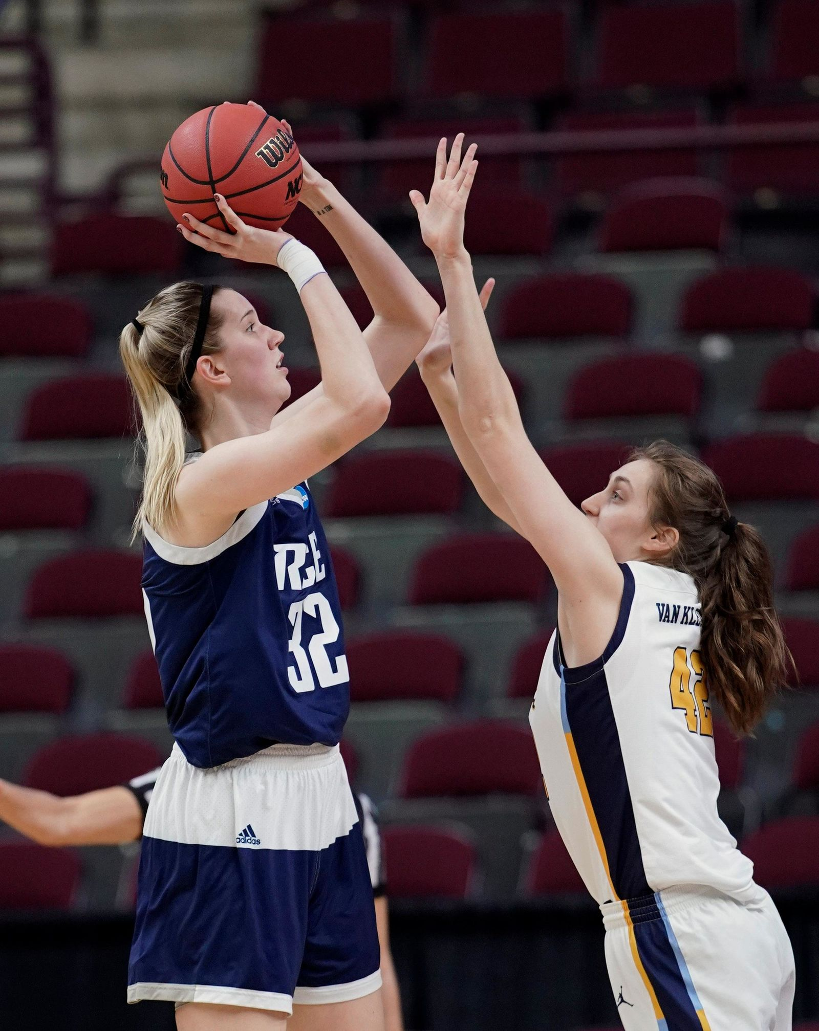 Rice's Nancy Mulkey (32) shoots as Marquette's Lauren Van Kleunen (42) defends during the first half of a first round women's college basketball game in the NCAA Tournament Friday, March 22, 2019, in College Station, Texas. (AP Photo/David J. Phillip)