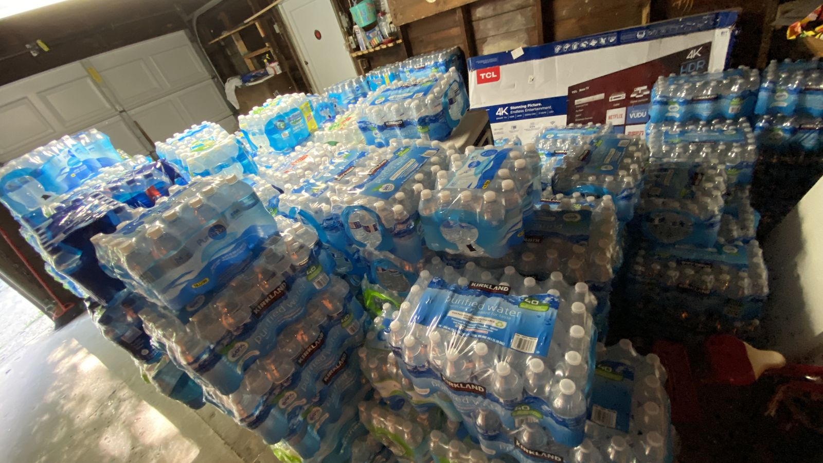 More than 250 cases of water fill Tamara Custard's garage Tuesday, July 27, 2020. Phase 1 of her plan is to gather as much water a possible for the city of Flint.{ } (WWMT/Jason Heeres)