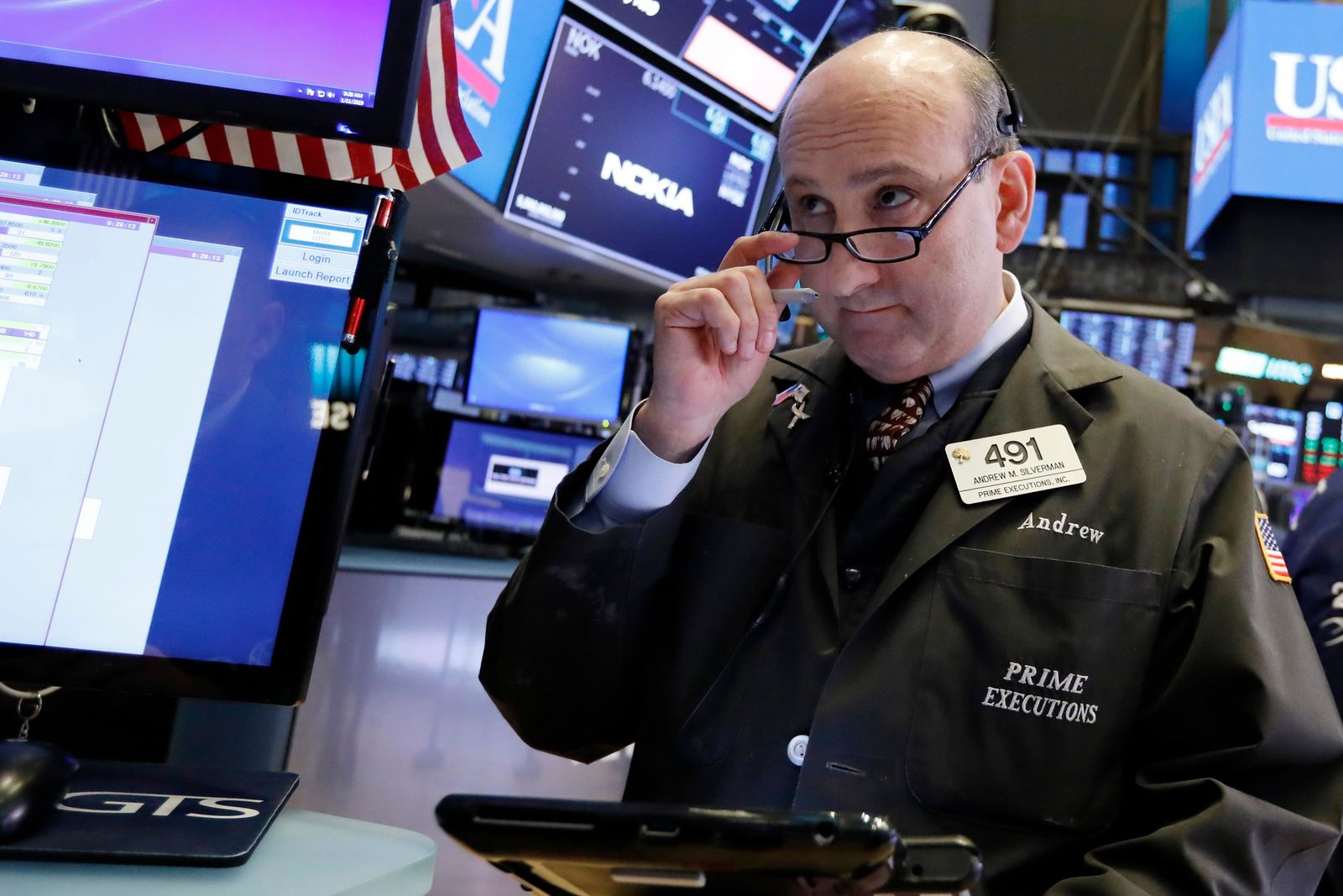 Trader Andrew Silverman works on the floor of the New York Stock Exchange, Friday, Jan. 11, 2019. (AP Photo/Richard Drew)
