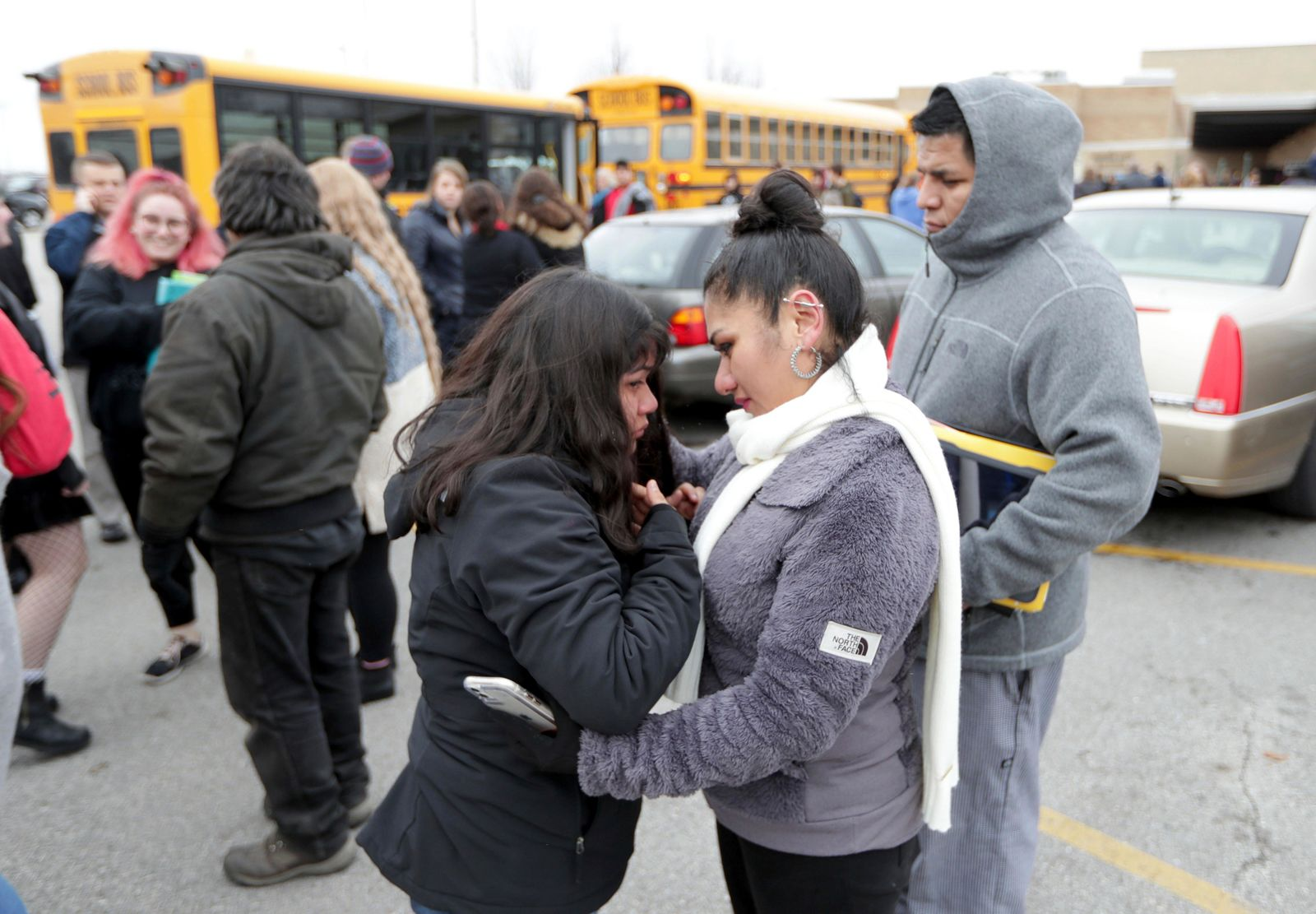 Becky Galvan consoles her daughter, Ashley Galvan a 15-year-old sophomore, with her father Jose Chavez outside Waukesha South High School in Waukesha on Monday, Dec. 2, 2019.{ } (Mike De Sisti/Milwaukee Journal-Sentinel via AP)