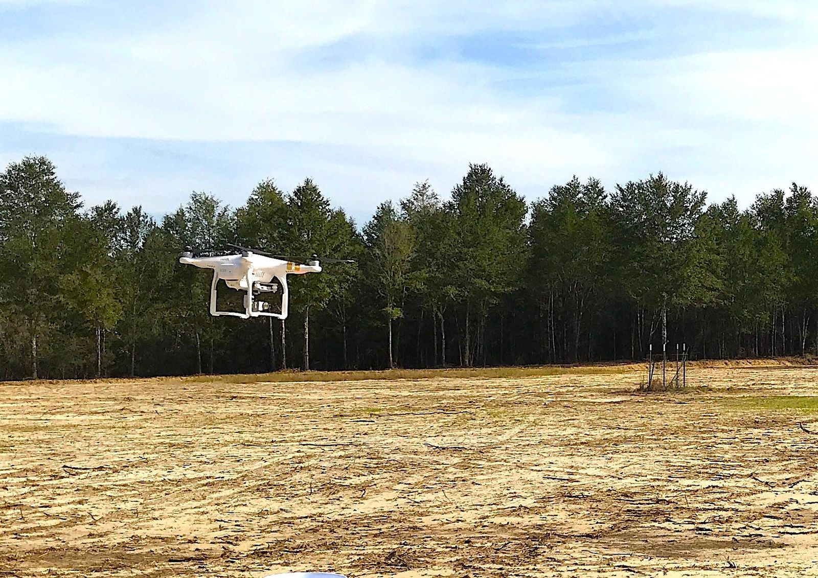"An unmanned aircraft piloted by a Crestview Police officer ""acquires a target"" with its camera as it hovers over a drone instruction course set up at land owned by the Hsu Educational Foundation near Laurel Hill. (Photo: Brian Hughes, Public Information Officer, City of Crestview)"