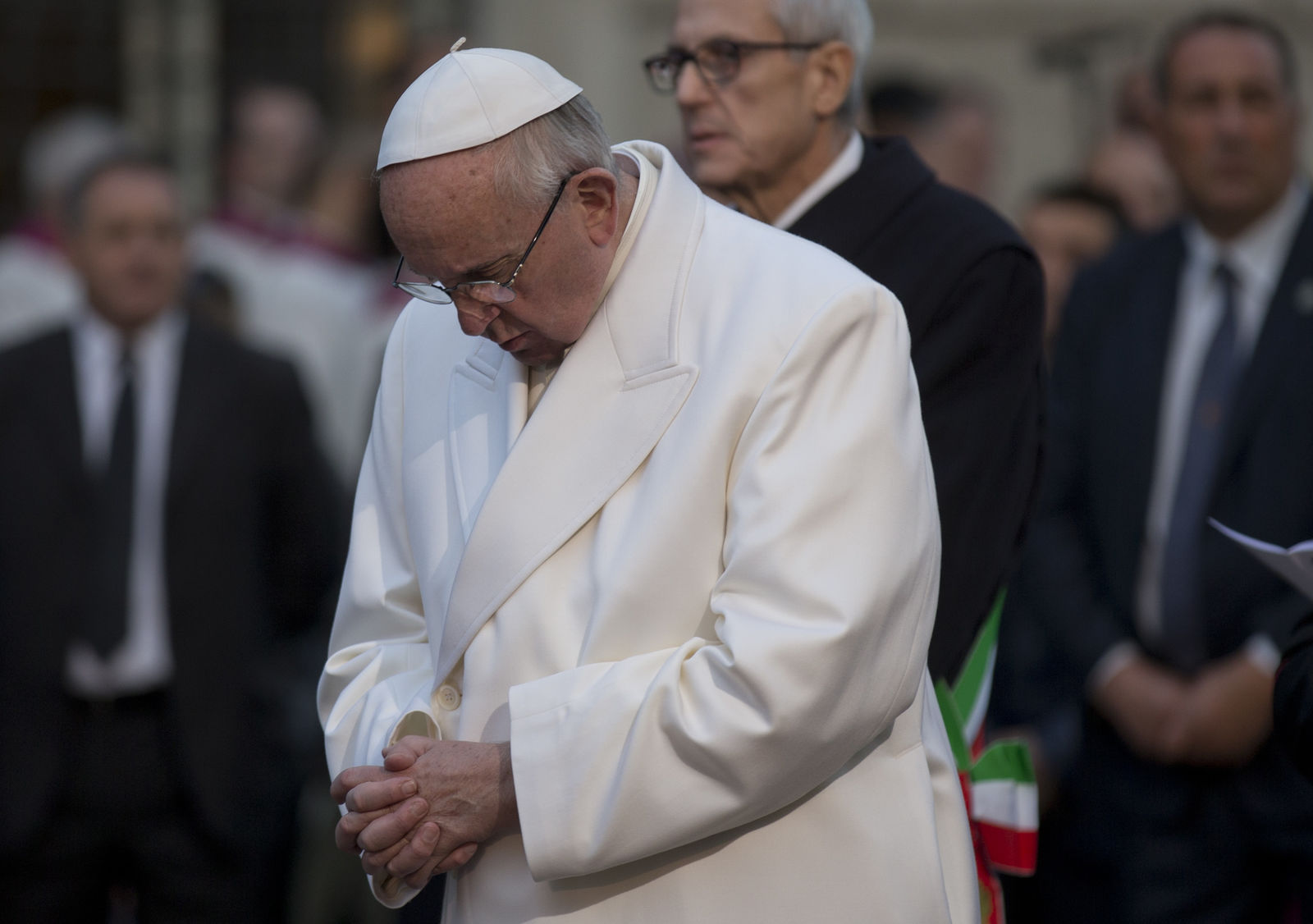Pope Francis prays in front of the statue of the Virgin Mary, on the occasion of the Immaculate Conception's feast, in Rome, Tuesday, Dec. 8, 2015. Pope Francis opened the great bronze doors of St. Peter's Basilica on Tuesday to launch his Holy Year of Mercy, declaring that mercy trumps moralizing in his Catholic Church. (AP Photo/Alessandra Tarantino)