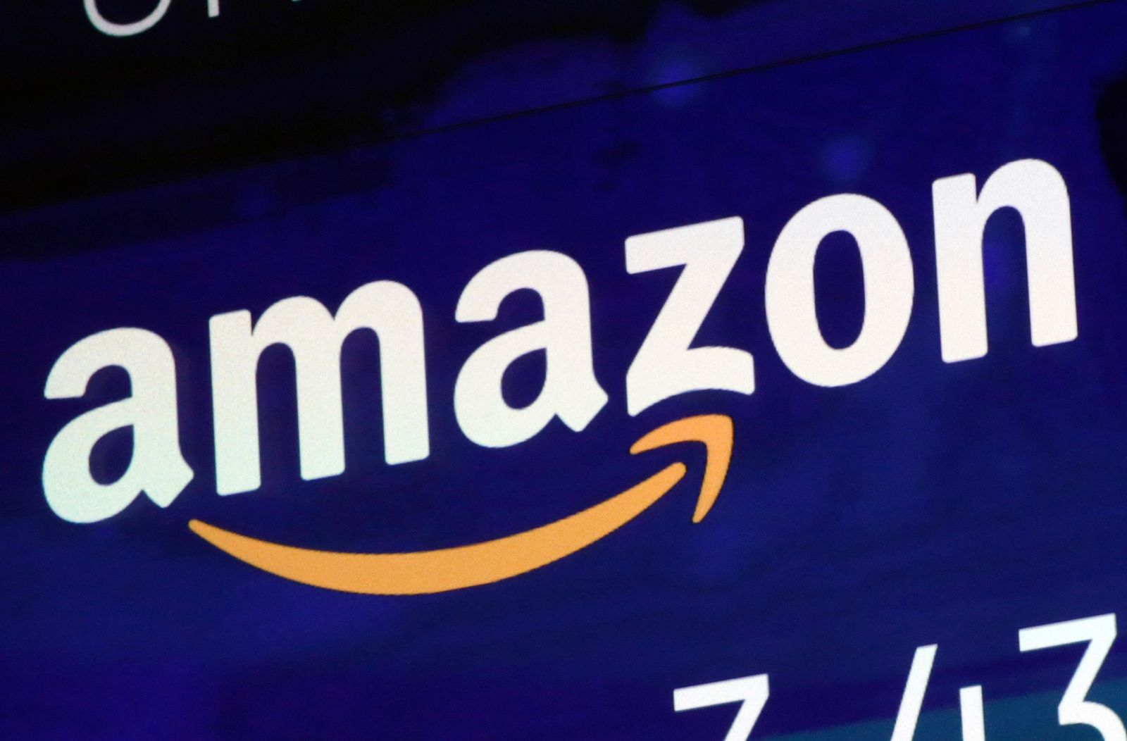 FILE - In this July 27, 2018 file photo, the logo for Amazon is displayed on a screen at the Nasdaq MarketSite in New York.{ } (AP Photo/Richard Drew, File)