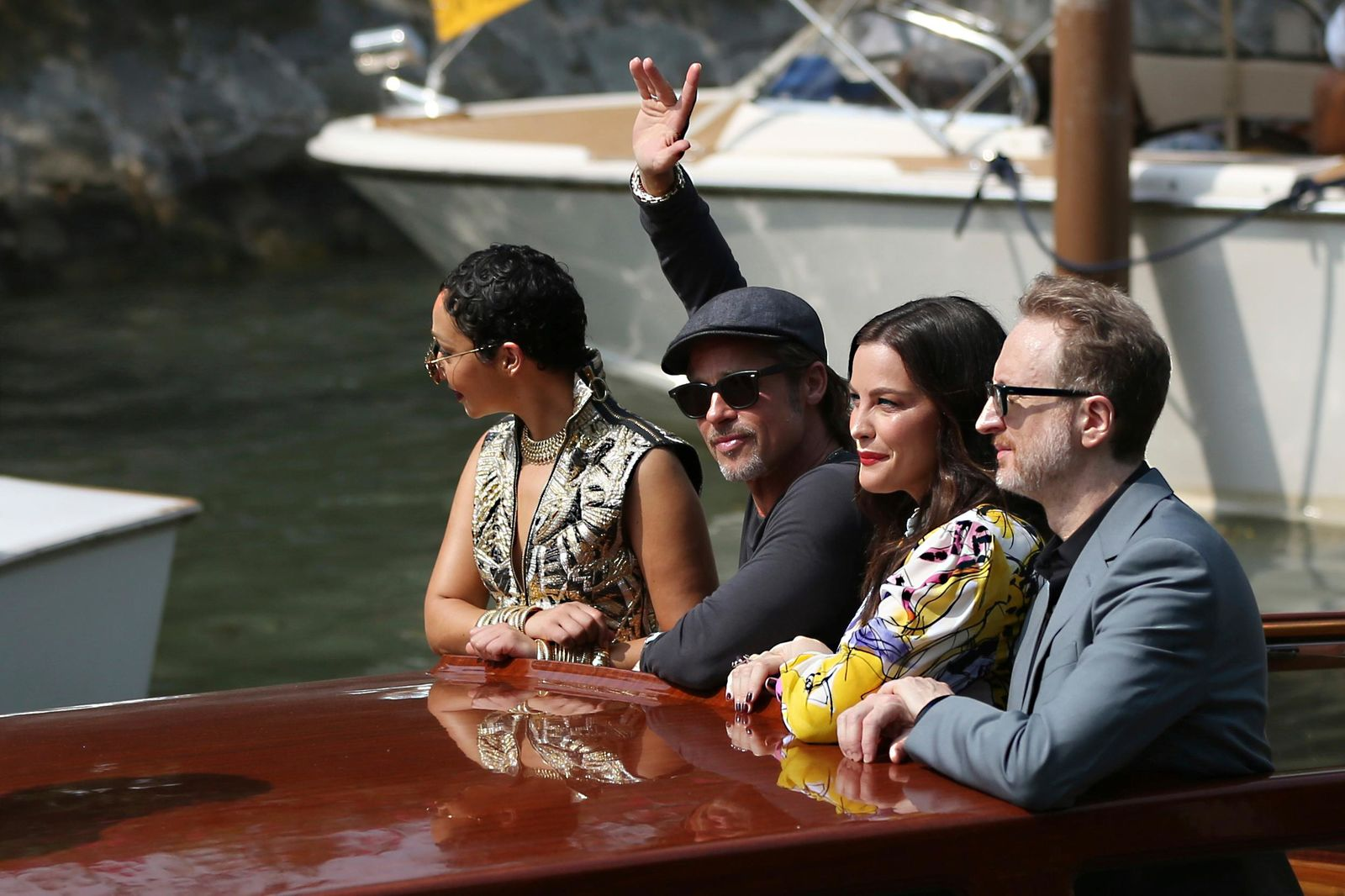 Actors Ruth Negga, from left, Brad Pitt, Liv Tyler and director James Gray pose for photographers upon arrival for the photo call of the film 'Ad Astra' at the 76th edition of the Venice Film Festival in Venice, Italy, Thursday, Aug. 29, 2019. (AP Photo/Dejan Jankovic/)