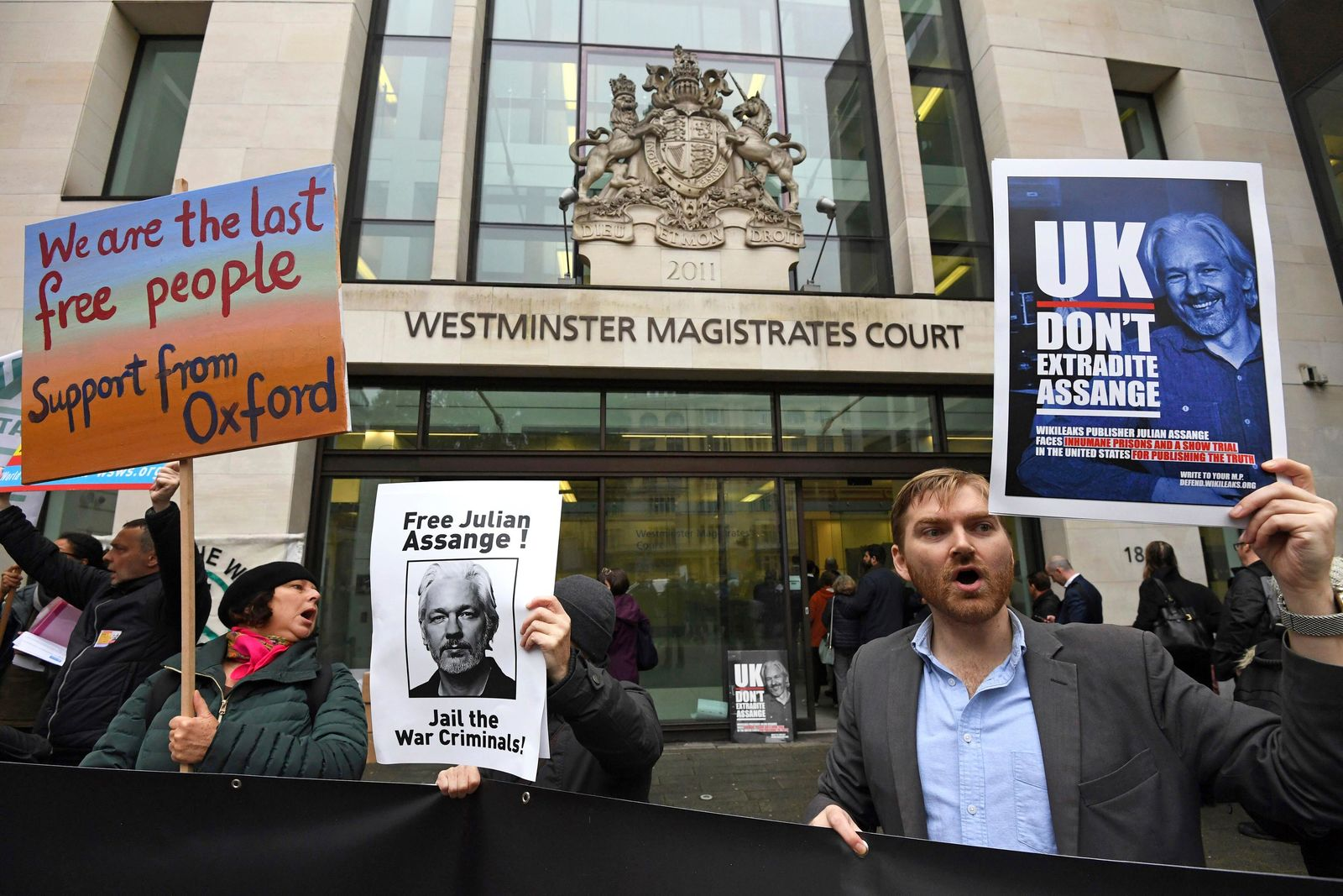Supporters of Wikileaks founder Julian Assange demonstrate oustide Westminster Magistrates' Court in London where Assange is expected to appear as he fights extradition to the United States on charges of conspiring to hack into a Pentagon computer, in London, Monday, Oct, 21, 2019. (Kirsty O'Connor/PA via AP)