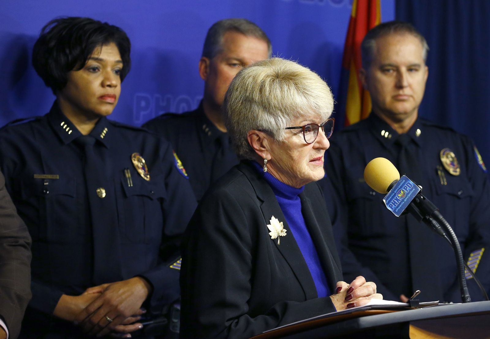 Phoenix Mayor Thelda Williams, front right, speaks during a news conference as she is joined by Phoenix Police Chief Jeri Williams, left, and other members of law enforcement as they announce that Nathan Sutherland, a licensed practical nurse, has been arrested on one count of sexual assault and one count of vulnerable adult abuse on an incapacitated woman who gave birth last month at a long-term health care facility Wednesday, Jan. 23, 2019, in Phoenix. Sutherland was one of the woman's caregivers at the Hacienda HealthCare facility and he was charged after authorities obtained a court order to take a DNA sample from him, which was compared to DNA of the baby boy, according to police. (AP Photo/Ross D. Franklin)