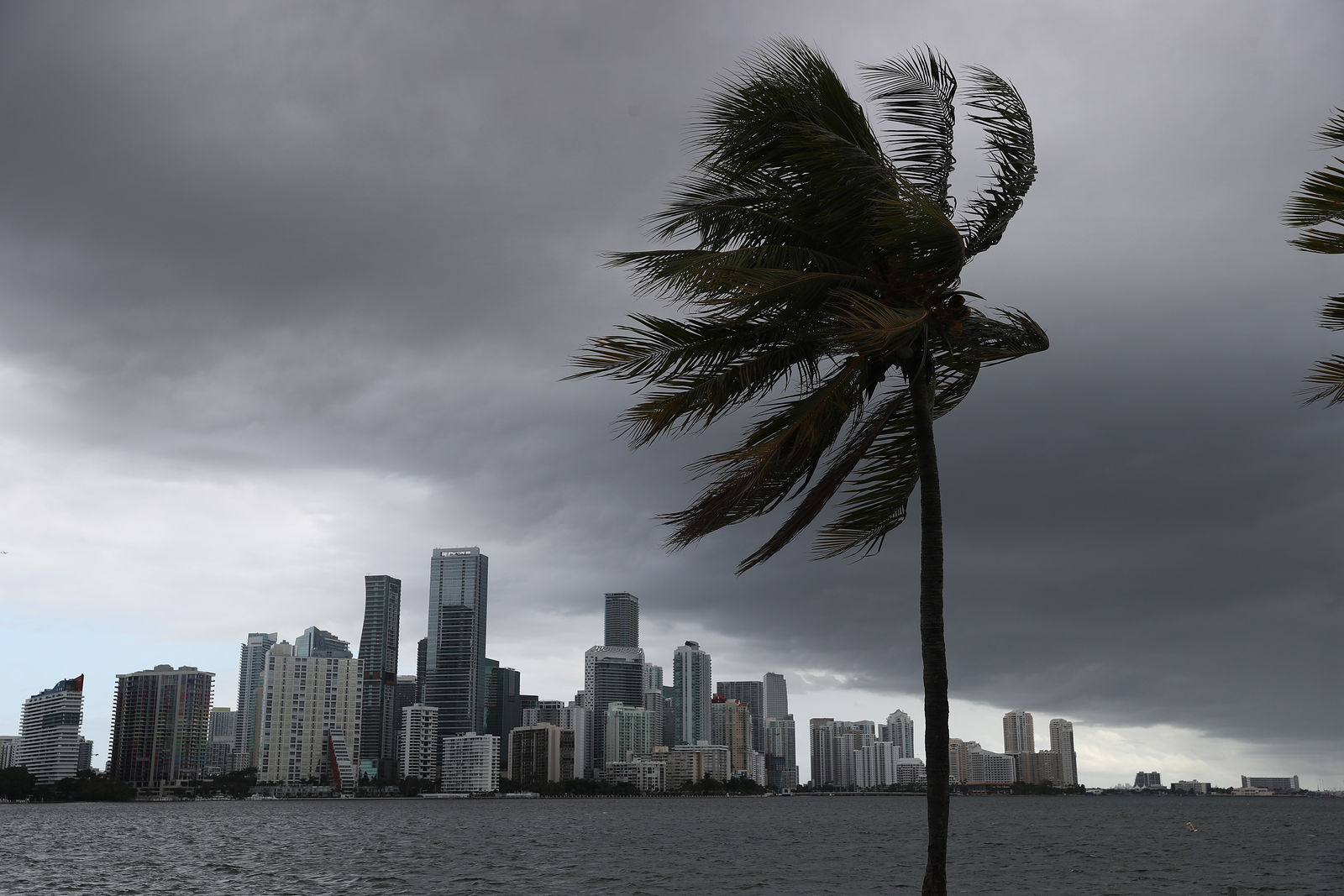 MIAMI, FLORIDA - AUGUST 01: Storm clouds are seen over the city as Hurricane Isaias approaches the east coast of Florida on August 01, 2020 in Miami, Florida. The hurricane is expected to brush past the east coast of Florida within the next 24 hours. (Photo by Joe Raedle/Getty Images)