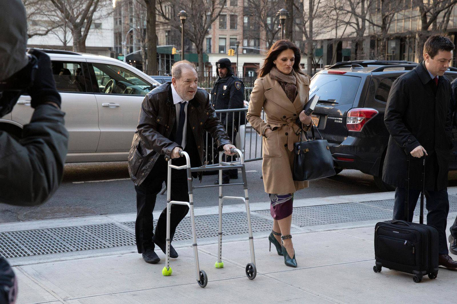 Harvey Weinstein and his attorney Donna Rotunno arrive at a Manhattan courthouse to attend jury selection for his trial on rape and sexual assault charges, Friday, Jan. 17, 2020 in New York. (AP Photo/Mark Lennihan)