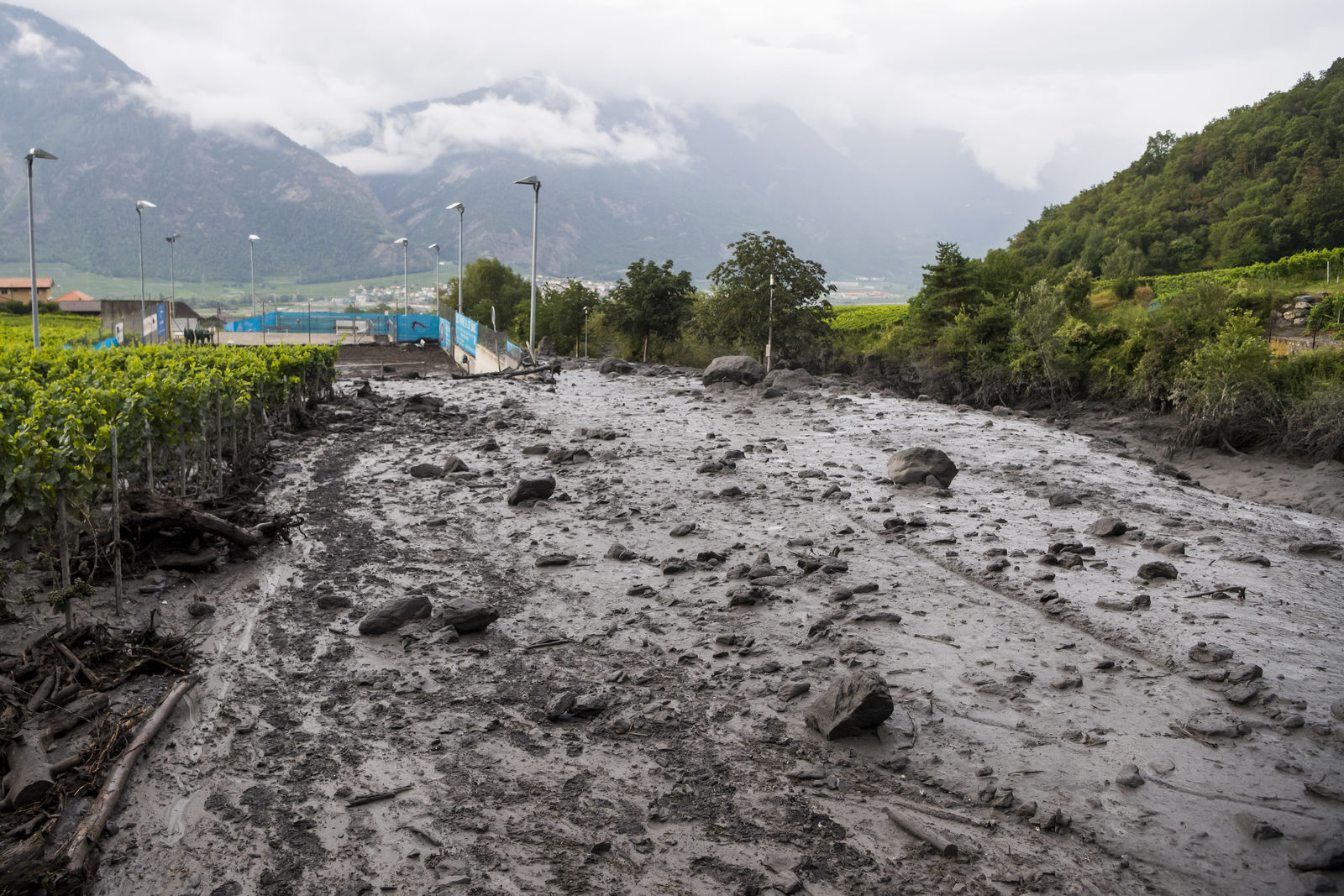 A view of the damage on the banks of the Losentse river on Monday, Aug.12, 2019 in Chamoson, canton Valais, Switzerland.{ } (Jean-Christophe Bott/Keystone via AP)