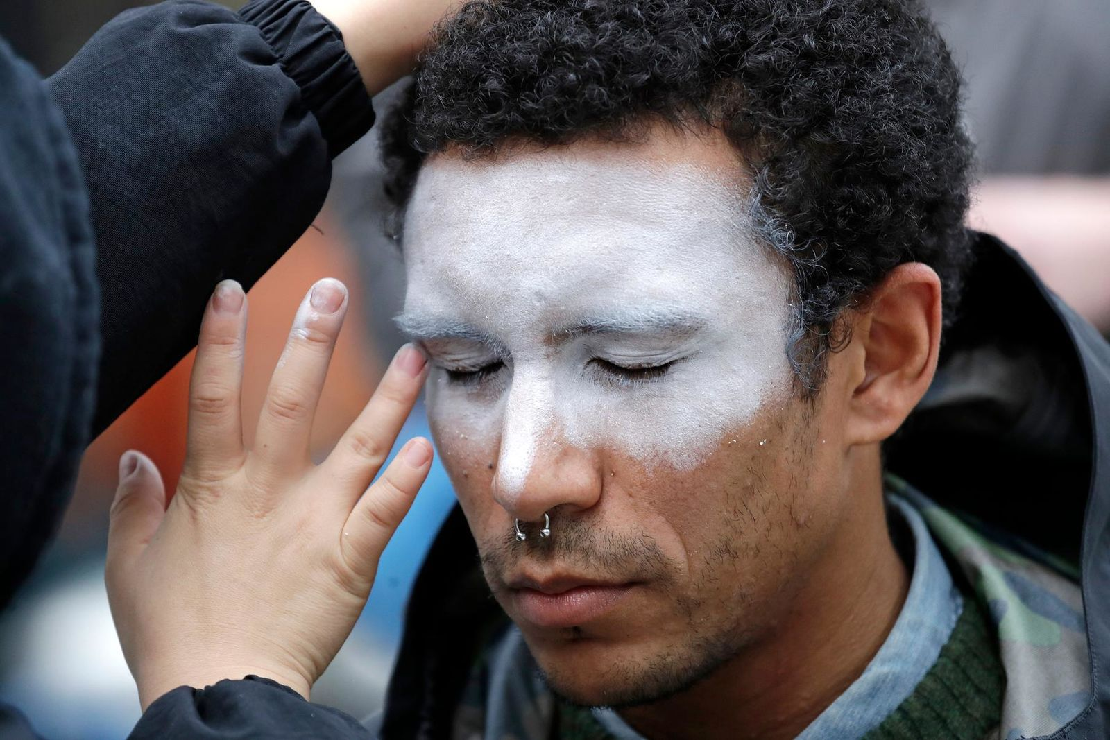 "FILE - In this Oct. 31, 2018, file photo, a man, who declined to be identified, has his face painted to represent efforts to defeat facial recognition during a protest at Amazon headquarters over the company's facial recognition system, ""Rekognition,"" in Seattle. San Francisco is on track to become the first U.S. city to ban the use of facial recognition by police and other city agencies as the technology creeps increasingly into daily life. Studies have shown error rates in facial-analysis systems built by Amazon, IBM and Microsoft were far higher for darker-skinned women than lighter-skinned men. (AP Photo/Elaine Thompson, File)"