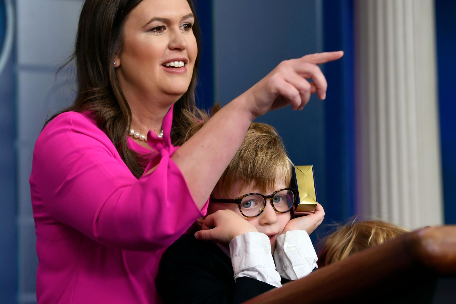 White House press secretary Sarah Sanders, standing next to her son Huck Sanders, calls on a child during a briefing at the White House in Washington, Thursday, April 25, 2019. . (AP Photo/Susan Walsh)