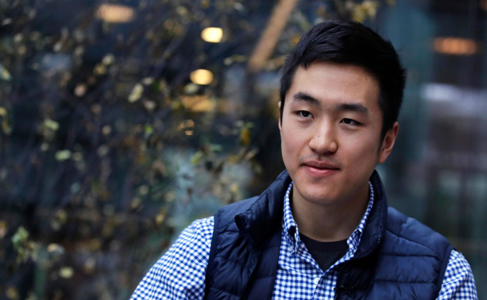 FILE - Harvard University graduate Jin K. Park, who holds a degree in molecular and cellular biology, listens during an interview in Cambridge, Mass., Thursday, Dec. 13, 2018. Park, who was named a Rhodes Scholar along with 30 other Americans in November, entered the U.S. illegally as a child, moving to Queens borough of New York City with his family. The undocumented student participates in the Deferred Action for Childhood Arrivals program (DACA). (AP Photo/Charles Krupa)