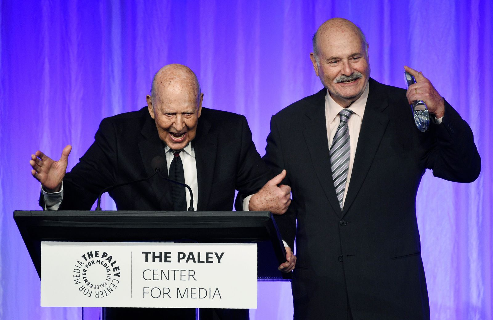 "Honoree Carl Reiner, left, is joined by his son Rob Reiner as he accepts his award at ""The Paley Honors: A Special Tribute to Television's Comedy Legends"" at the Beverly Wilshire Hotel, Thursday, Nov. 21, 2019, in Beverly Hills, Calif. (Photo by Chris Pizzello/Invision/AP)"
