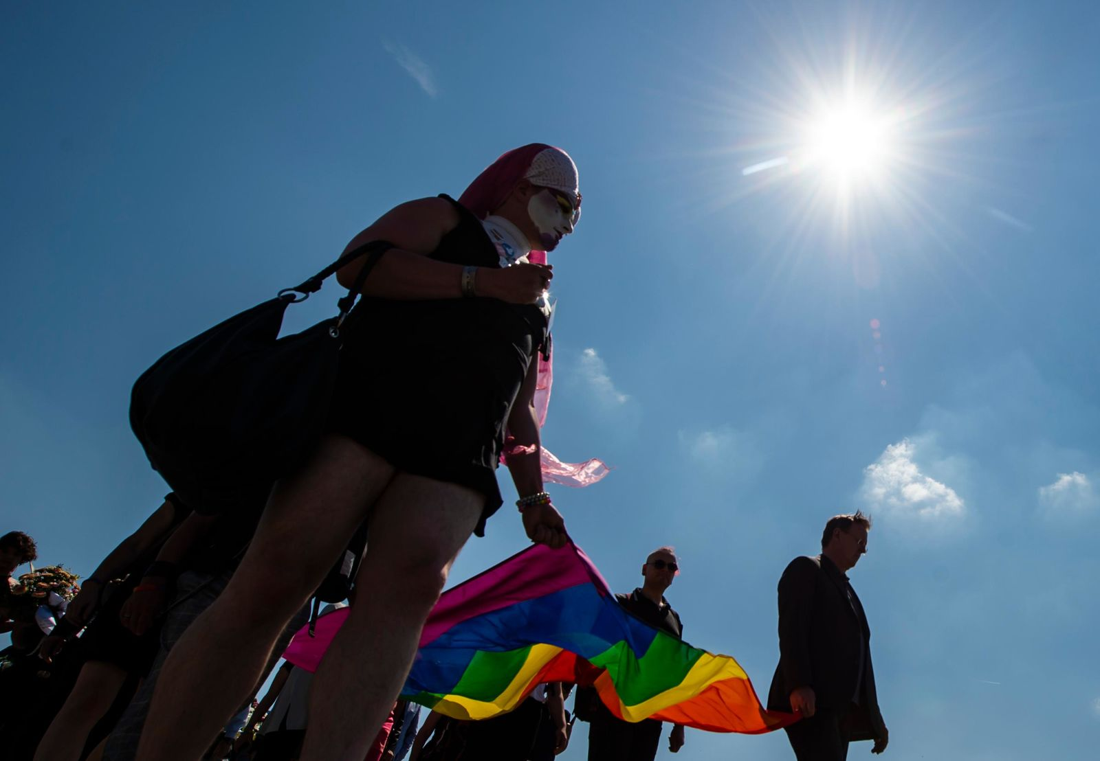 People carry a rainbow flag in remembrance for prisoners assigned a pink triangle in the former Nazi concentration camp Buchenwald within the Christopher Street Day in Weimar, Germany, Sunday, June 23, 2019. There were 650 prisoners assigned a pink triangle in the Buchenwald concentration camp between 1937 and 1945. Many of them lost their lives. (AP Photo/Jens Meyer)