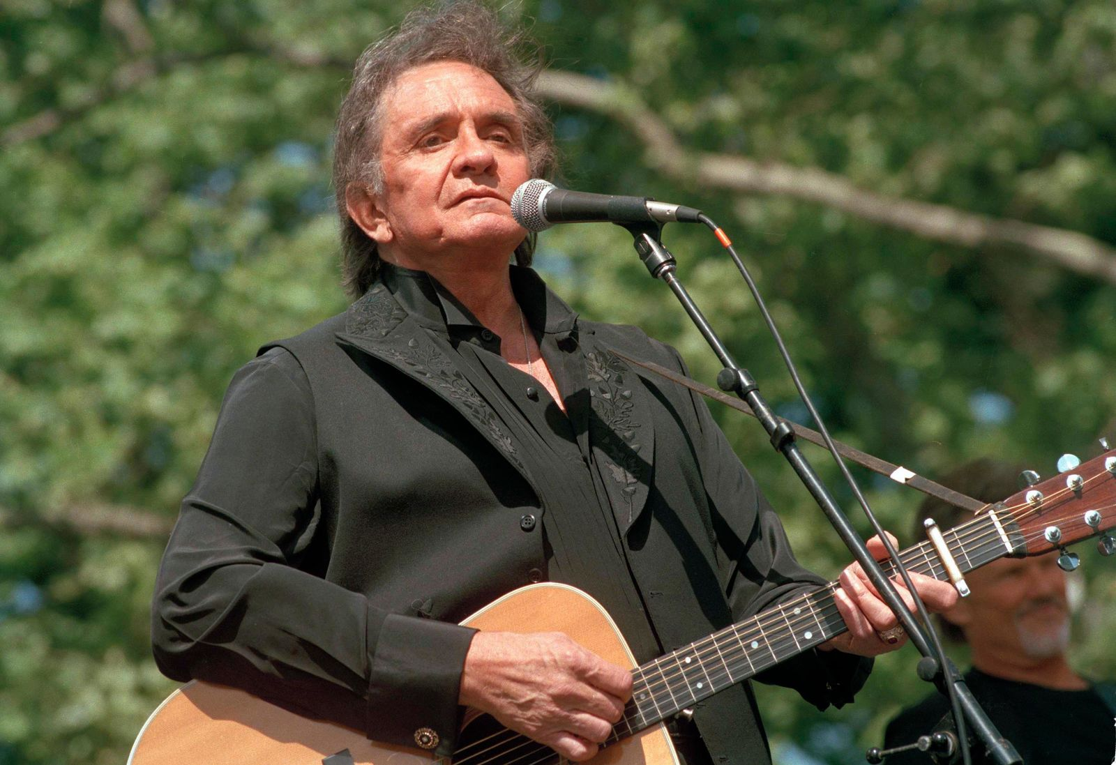 FILE - In this May 23, 1993 file photo, country legend Johnny Cash performs at a benefit concert at Central Park in New York. (AP Photo/Joe Tabacca, File)