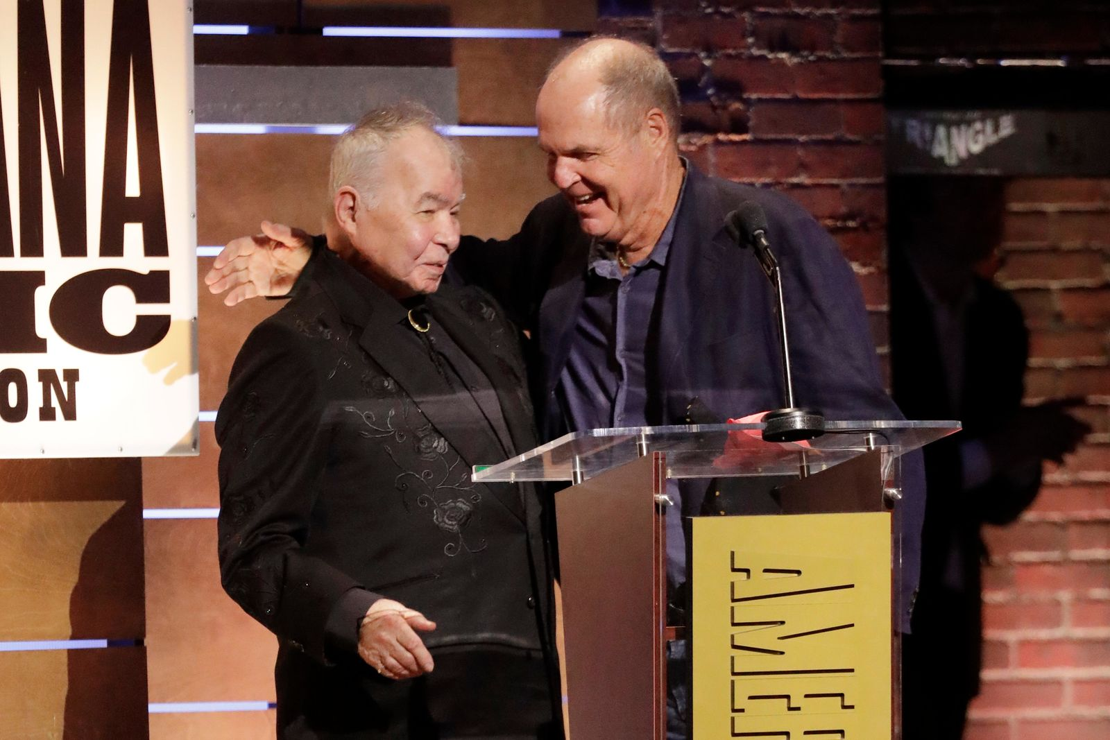 "John Prine, left, and Pat McLaughlin accept the Song of the Year Award for ""Summer's End"" at the Americana Honors & Awards show Wednesday, Sept. 11, 2019, in Nashville, Tenn. (AP Photo/Wade Payne)"