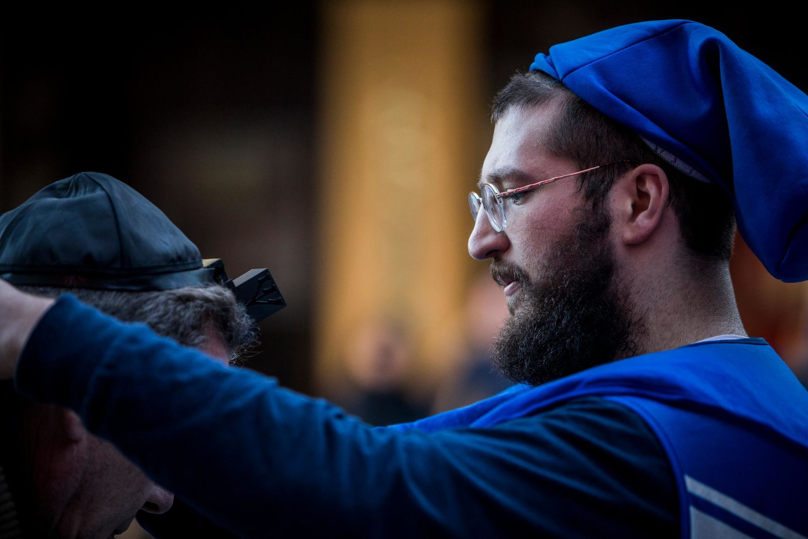 Shlomo Sirota wraps the tefillin around an attendee of the Grand Menorah Lighting in downtown Las Vegas on Sunday, Dec. 2. The ceremony featured a 20-foot Grand Menorah, which will remain on display throughout the Hanukkah season. CREDIT: Joe Buglewicz/Las Vegas News Bureau