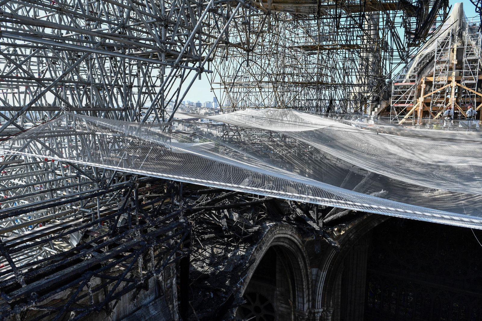 Parts of a destroyed ribbed vault and scaffolding are pictured at the Notre-Dame de Paris Cathedral, Wednesday, July 17, 2019 in Paris. . (Stephane de Sakutin/Pool via AP)
