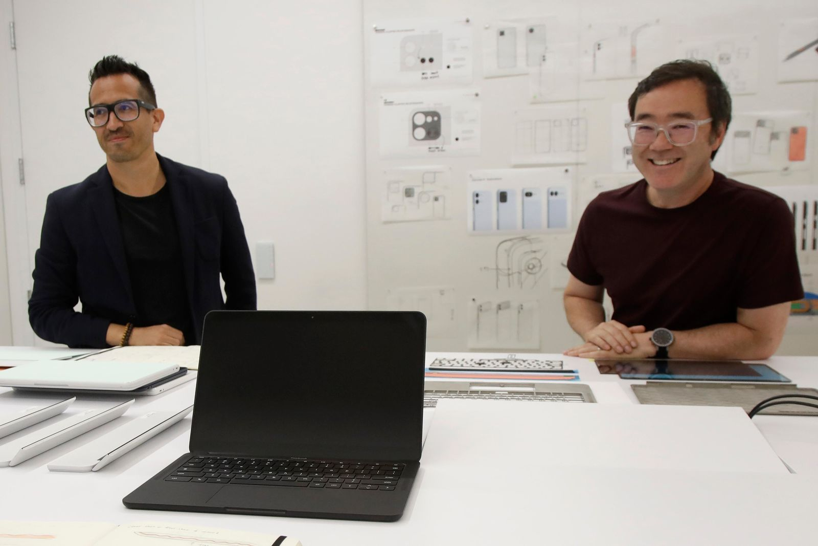 In this Tuesday, Sept. 24, 2019, photo a new Pixel laptop computer is shown in front of Alberto Villarreal, Creative Lead for Mobile and Laptops, left, and Max Yoshimoto, Design Director of Mobile and Create, at Google in Mountain View, Calif. (AP Photo/Jeff Chiu)
