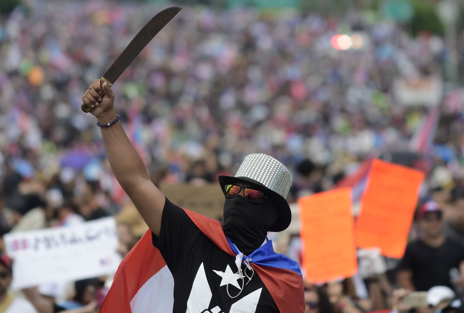 A demonstrator brandishes a machete during a march on Las Americas highway to demand the resignation of governor Ricardo Rossello, in San Juan, Puerto Rico, Monday, July 22, 2019.{ } (AP Photo/Carlos Giusti)