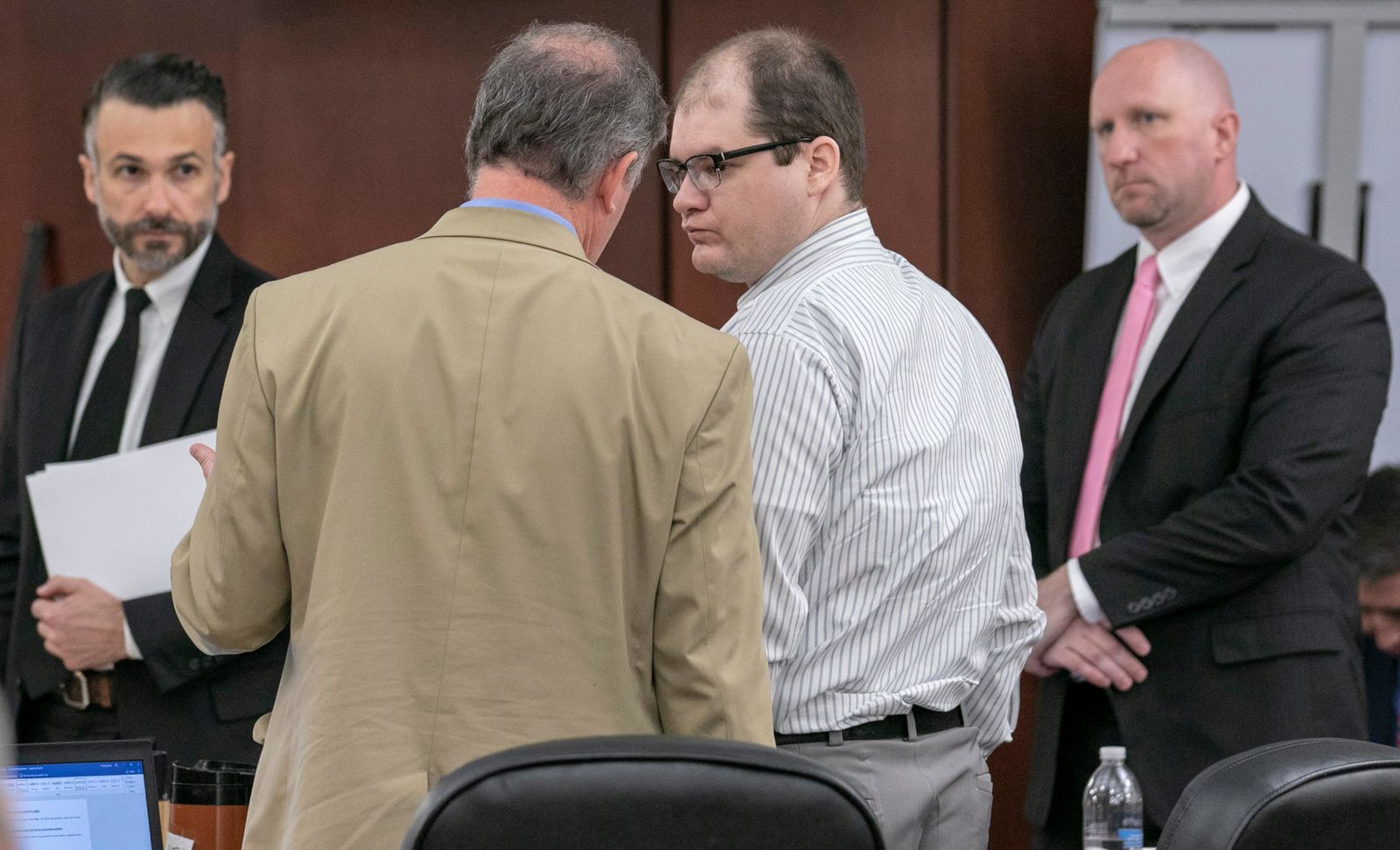 Defense attorney Boyd Young talks with Tim Jones, center, during the sentencing phase of his trial in Lexington, S.C. Timothy Jones, Jr. was found guilty of killing his 5 young children in 2014.  (Tracy Glantz/The State via AP, Pool)