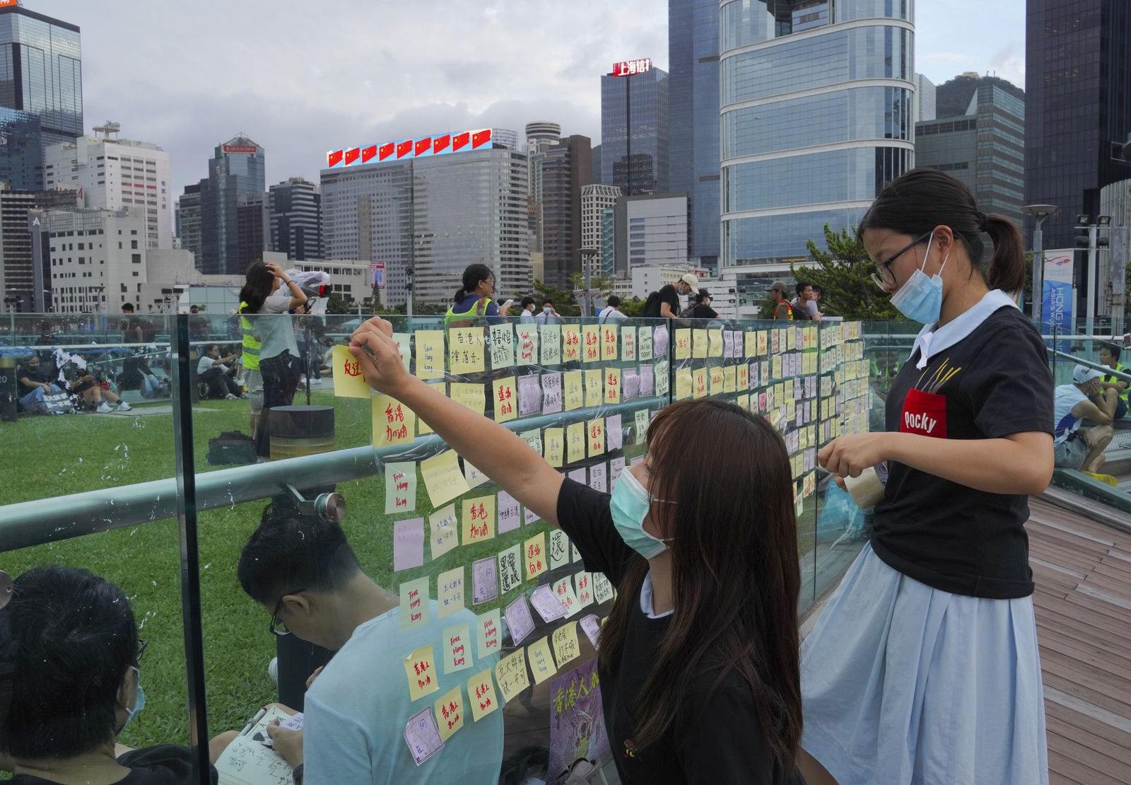 FILE- Protesters put their massage on Sticky Note Lennon Walls during continuing pro-democracy rallies in Tamar Park, Hong Kong, on Tuesday, Sept. 3, 2019. Hong Kong leader Carrie Lam said Tuesday she has never tendered her resignation to China over the anti-government protests that have roiled the city for three months. (AP Photo/Vincent Yu)