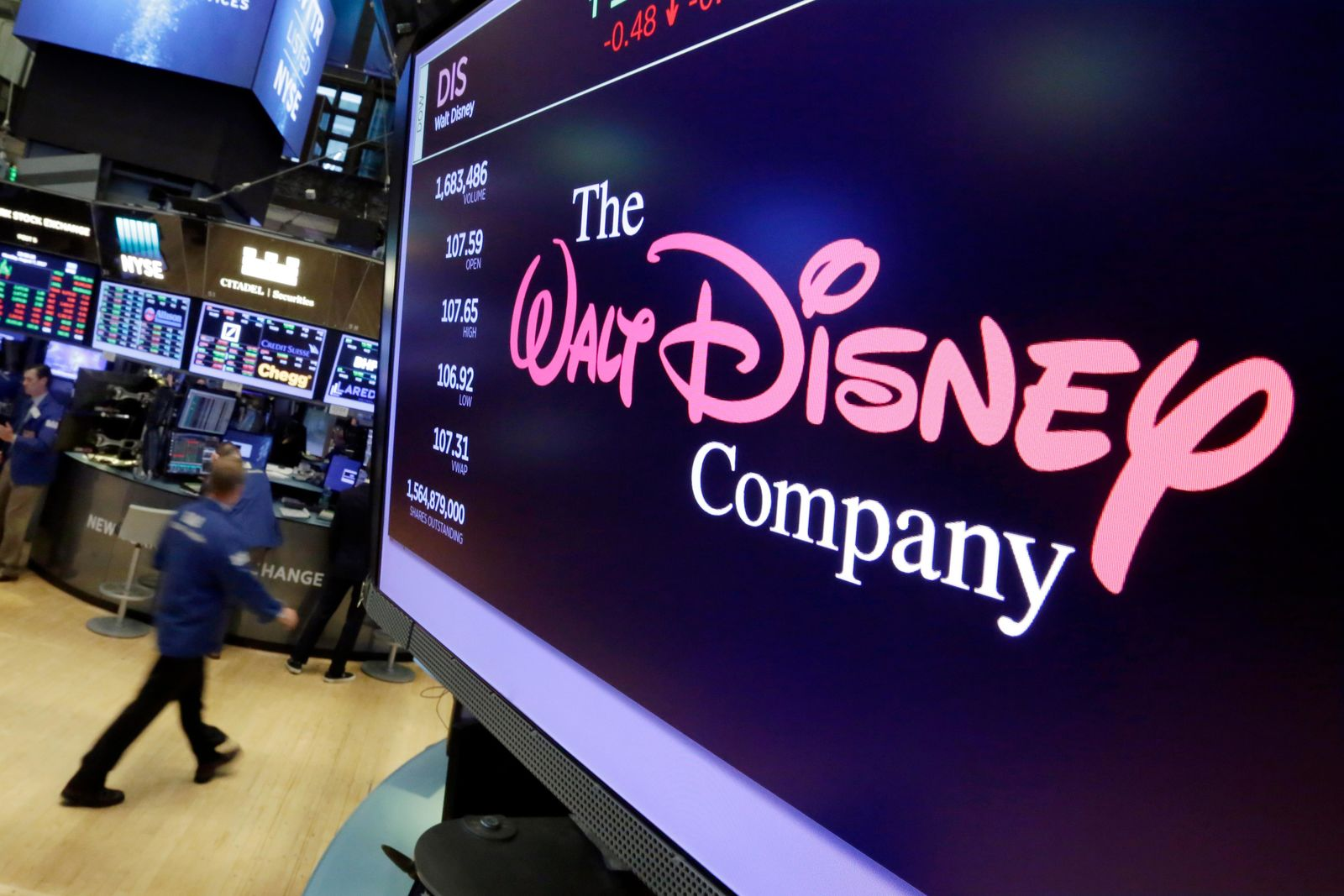 FILE - In this Monday, Aug. 7, 2017, file photo, The Walt Disney Co. logo appears on a screen above the floor of the New York Stock Exchange. Disney is seeking new frontiers. (AP Photo/Richard Drew, File)
