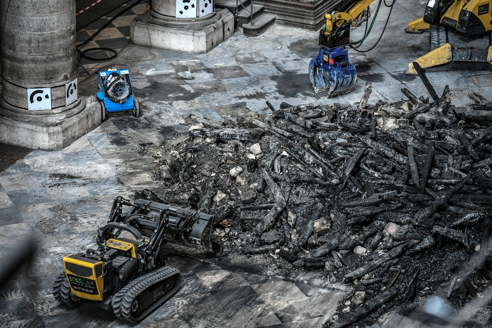 Excavators are pictured during preliminary work at the Notre-Dame de Paris Cathedral, Wednesday, July 17, 2019 in Paris. The chief architect of France's historic monuments says that three months after the April 15 fire that devastated Notre Dame Cathedral the site is still being secured. (Stephane de Sakutin/Pool via AP)