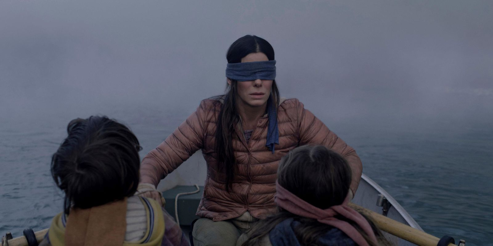 "FILE- This file image released by Netflix shows Sandra Bullock in a scene from the film, ""Bird Box."" (Merrick Morton/Netflix via AP, File)"