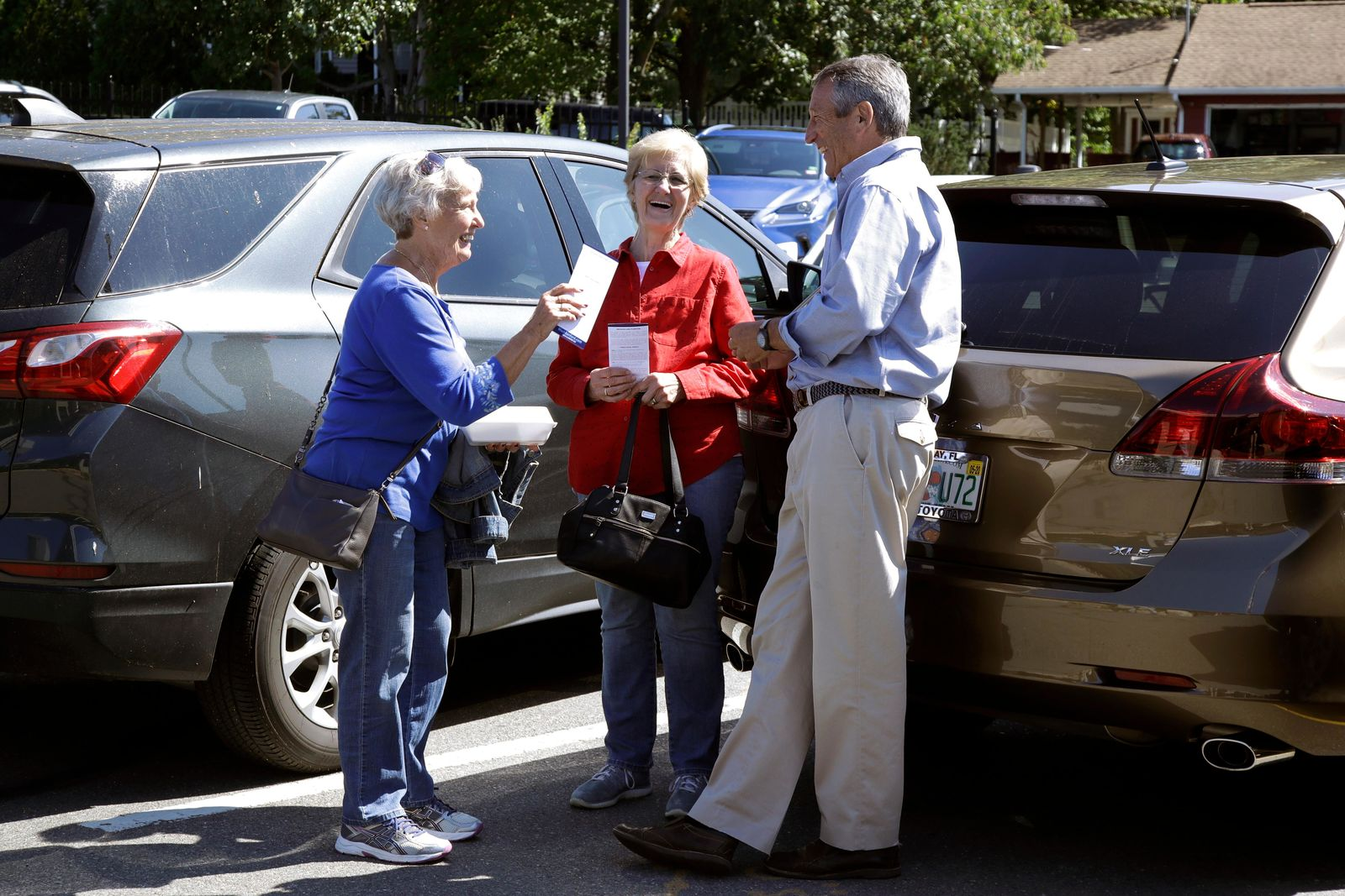 Republican presidential candidate, former South Carolina Gov. Mark Sanford talks with customers in the parking lot of the Puritan Backroom restaurant, during a campaign stop, Thursday, Sept. 19, 2019, in Manchester, N.H. (AP Photo/Elise Amendola)