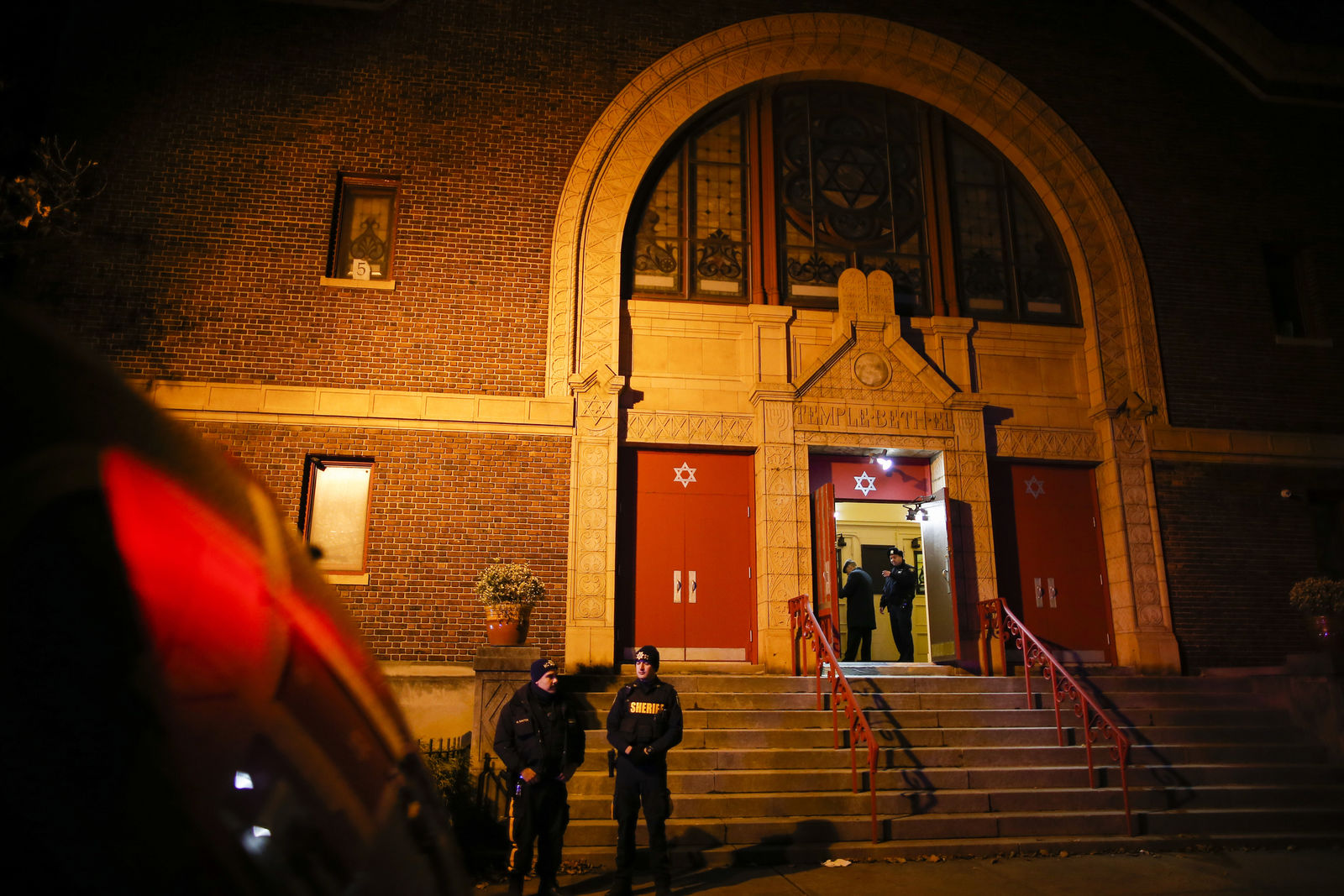Officers stand outside of a vigil for the victims of a shooting in Jersey City, N.J., Wednesday, Dec. 11, 2019. Fears that a deadly shooting at a Jewish market  was an anti-Semitic attack mounted as authorities recounted how a man and woman deliberately pulled up to the place in a stolen rental van with at least one rifle and got out firing. (AP Photo/Eduardo Munoz Alvarez)