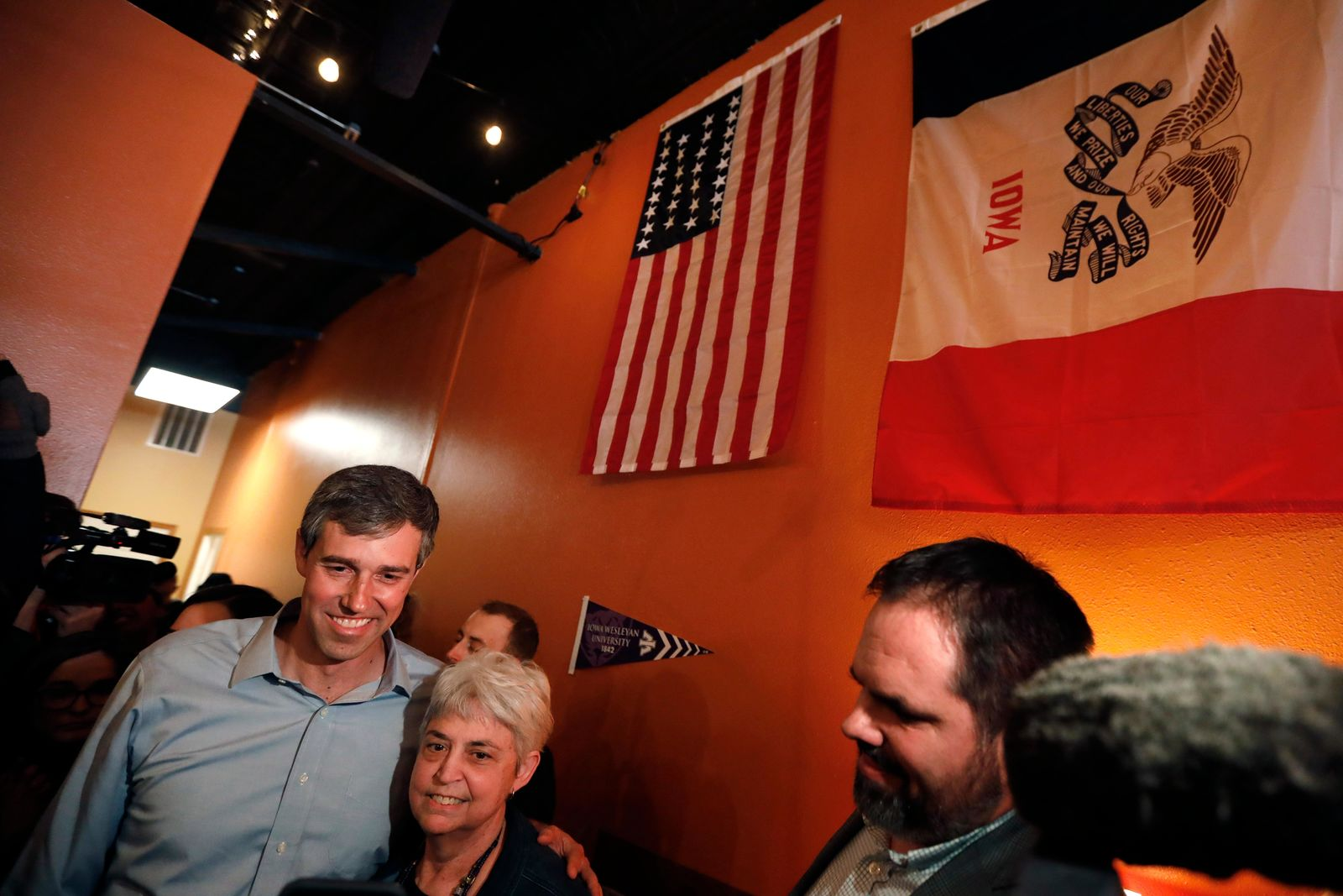 Former Texas congressman Beto O'Rourke poses for a photo with an audience member during a stop at the Central Park Coffee Company, Friday, March 15, 2019, in Mount Pleasant, Iowa. (AP Photo/Charlie Neibergall)