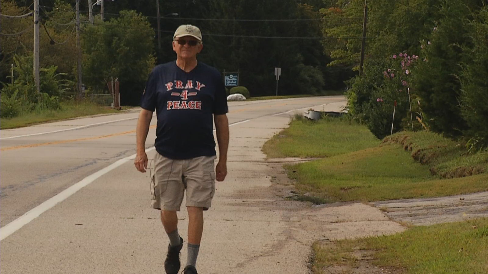 "Al Forte stopped in Narragansett Thursday, Aug. 29, 2019 on his ""Pray-for-Peace Walk"" that started in New York City and will end in Boston. (WJAR)"
