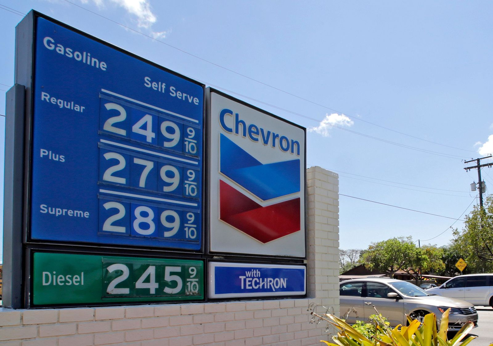 This Wednesday, May 3, 2017, photo shows a a sign with gas prices at a Chevron station in Miami. Chevron Corp. reports earnings Friday, Oct. 27, 2017. (AP Photo/Alan Diaz)