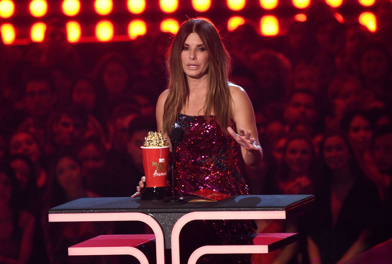 "Sandra Bullock accepts the award for most frightened performance for ""Bird Box"" at the MTV Movie and TV Awards on Saturday, June 15, 2019, at the Barker Hangar in Santa Monica, Calif. (Photo by Chris Pizzello/Invision/AP)"