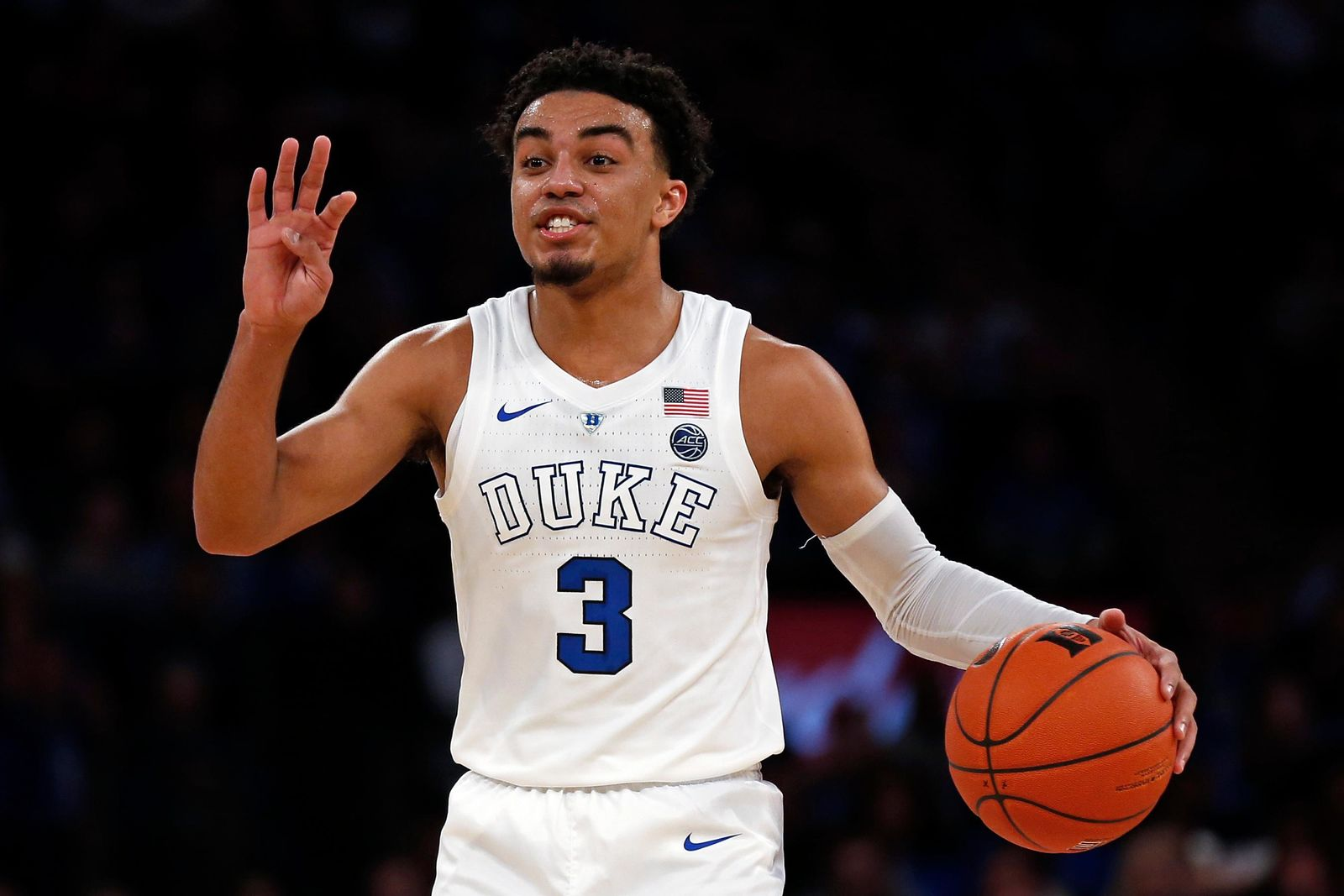 FILE - In this Dec. 20, 2018, file photo, Duke guard Tre Jones gestures to teammates during the first half of the team's NCAA college basketball game against Texas Tech in New York. Duke has regained the top spot in The Associated Press Top 25 following a win over No. 12 Texas Tech at Madison Square Garden. (AP Photo/Adam Hunger, File)