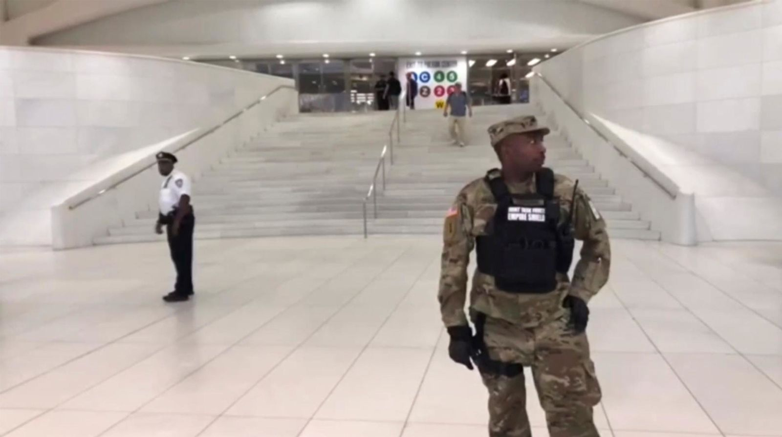 This still image provided by WABC-TV shows law enforcement standing in front of a New York City Subway entrance at the Oculus transportation hub after reports of a suspicious package on a subway platform in New York on Friday, Aug. 16, 2019. (WABC-TV via AP)