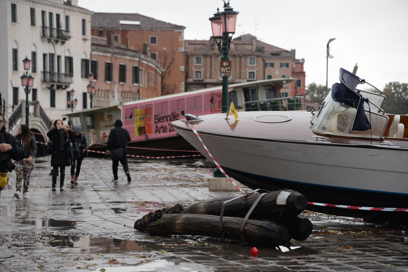 Boats are stranded on the docks after a high tide, in Venice, Italy, Wednesday, Nov. 13, 2019. Andrea Merola/ANSA via AP)