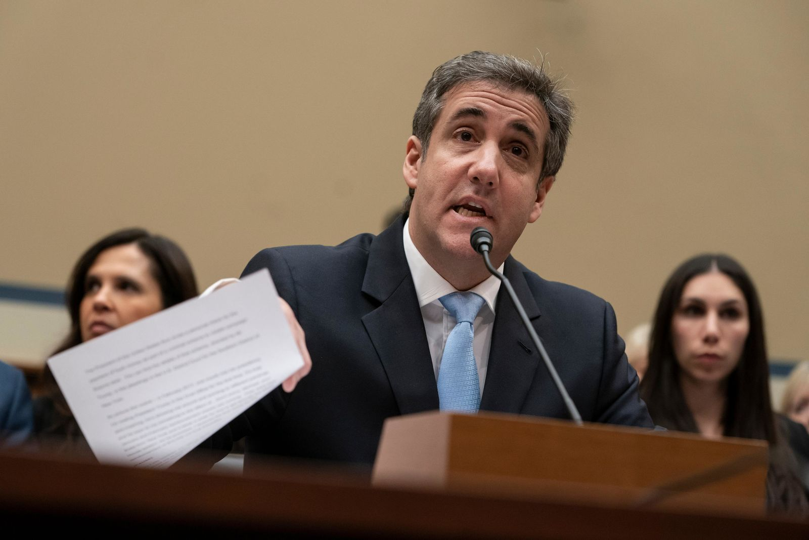 FILE - In this Feb. 27, 2019, file photo, Michael Cohen, President Donald Trump's former personal lawyer, reads an opening statement as he testifies before the House Oversight and Reform Committee on Capitol Hill in Washington.{ } to porn actress Stormy Daniels and Playboy centerfold Karen McDougal. (AP Photo/J. Scott Applewhite, File)
