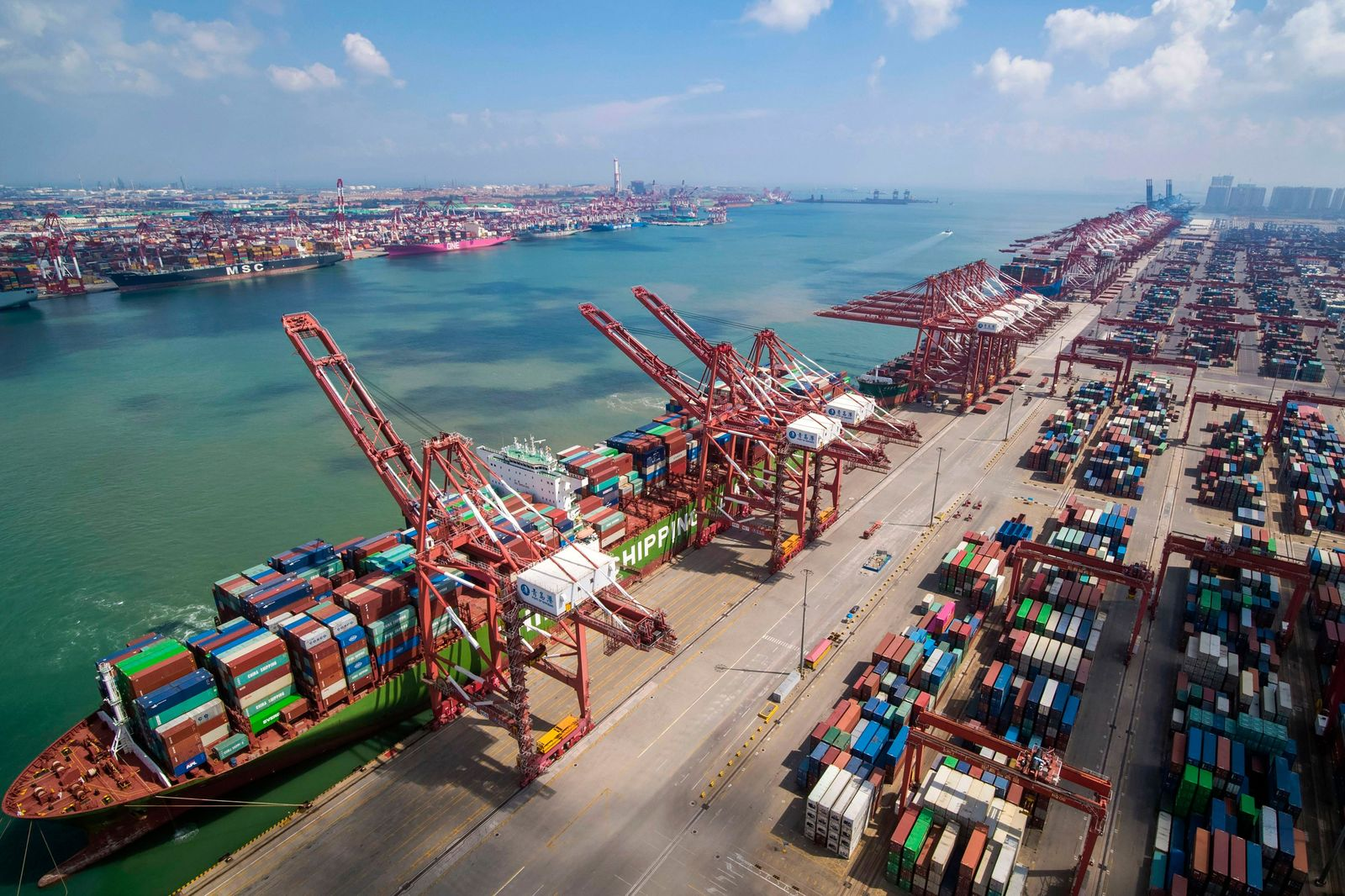 FILE - In this Aug. 6, 2019, photo, a container ship is docked a port in Qingdao in eastern China's Shandong province. U.S. President Donald Trump angrily escalated his trade fight with China on Friday, Aug. 23, 2019. (Chinatopix via AP)