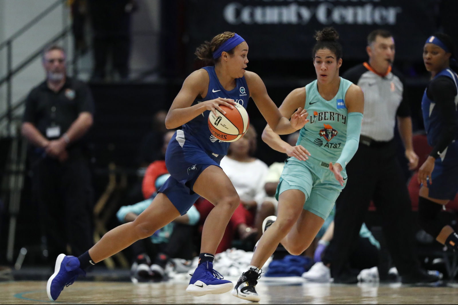 Minnesota Lynx forward Napheesa Collier, left, drives toward the basket with New York Liberty guard Kia Nurse (5) defending during the first half of a WNBA basketball game Tuesday, Aug. 13, 2019, in White Plains, N.Y. (AP Photo/Kathy Willens)