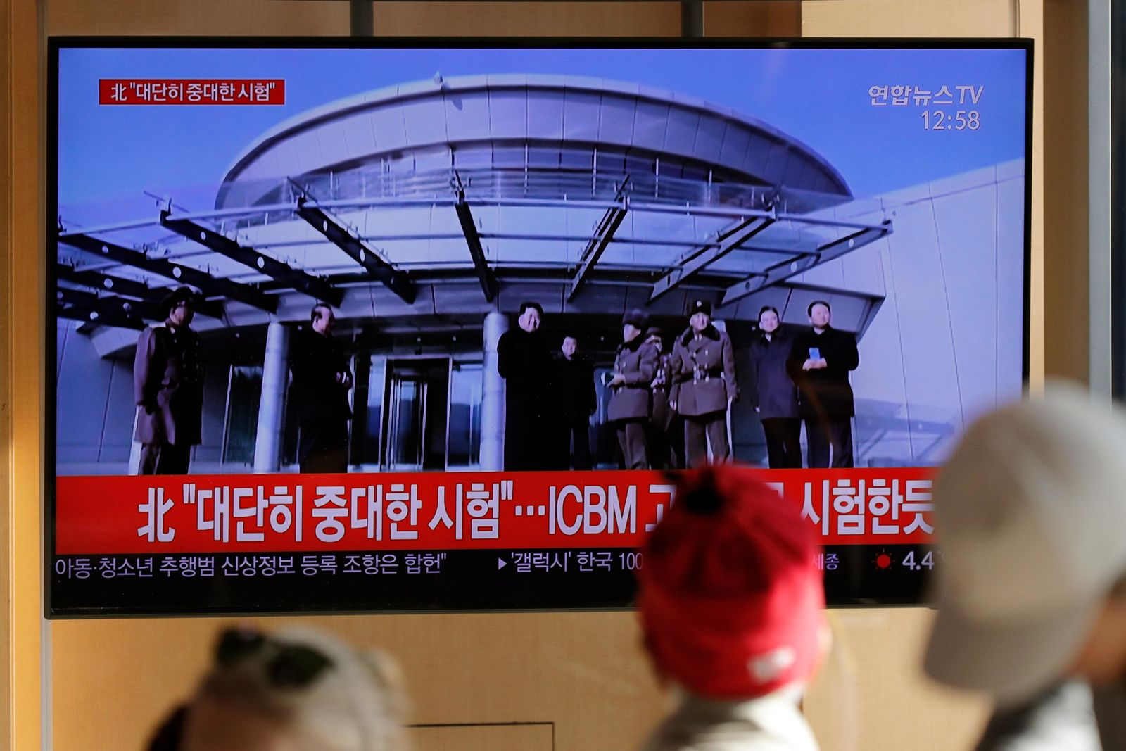 "People watch a TV news program reporting North Korea's announcement with a file footage of North Korean leader Kim Jong Un, at the Seoul Railway Station in Seoul, South Korea, Sunday, Dec. 8, 2019. North Korea said Sunday it carried out a ""very important test"" at its long-range rocket launch site that U.S. and South Korean officials said the North had partially dismantled as part of denuclearization steps. The letters read ""North. Very important test."" (AP Photo/Lee Jin-man)"