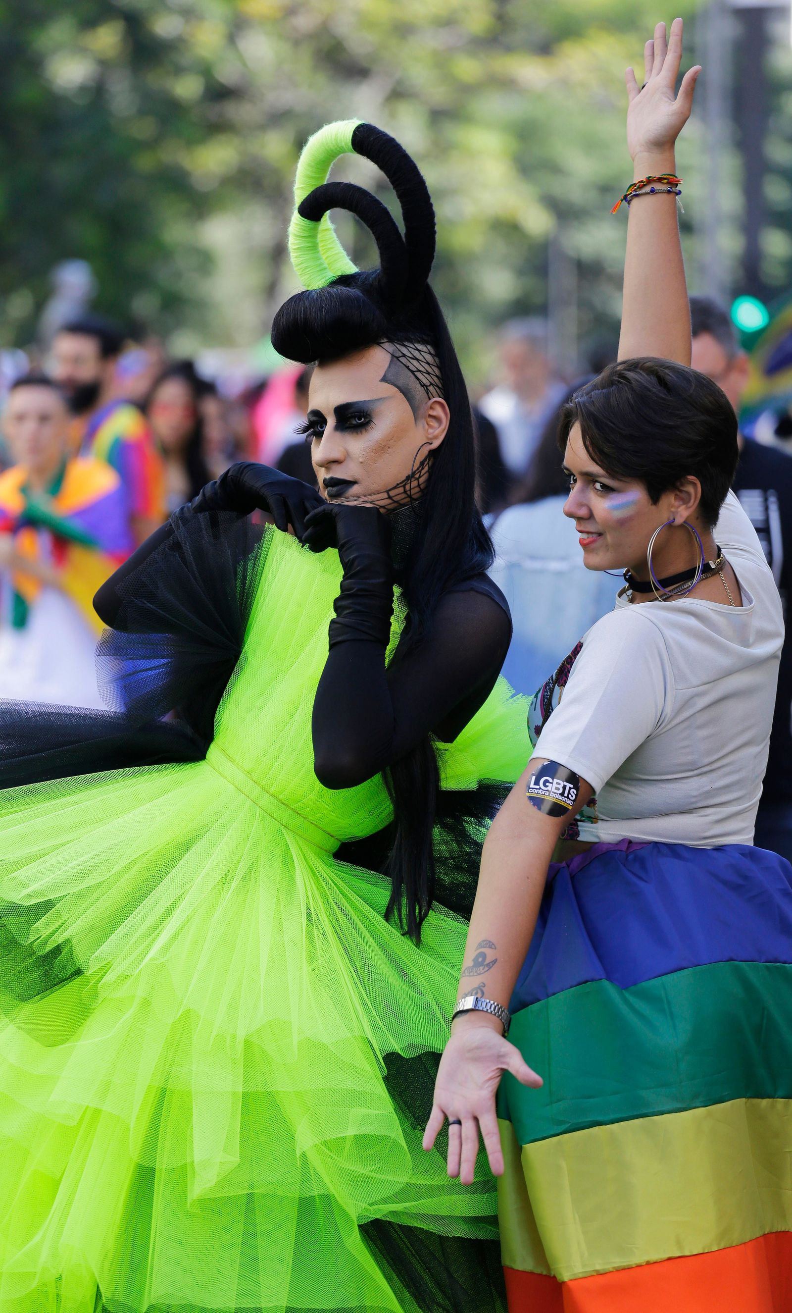 Revelers strike a pose during the annual gay pride parade along Paulista avenue in Sao Paulo, Brazil, Sunday, June 23, 2019. (AP Photo/Nelson Antoine)