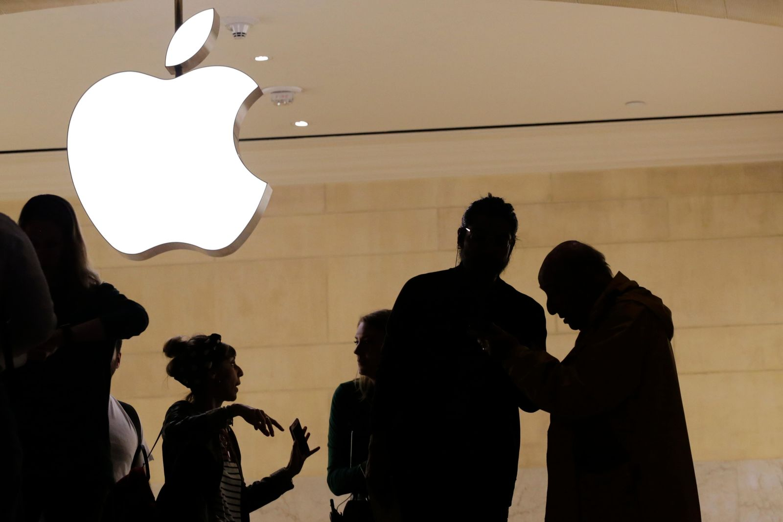 FILE- In this May 31, 2018, file photo customers enter the Apple store in New York. The Supreme Court is allowing consumers to pursue an antitrust lawsuit that claims Apple has unfairly monopolized the market for the sale of iPhone apps. (AP Photo/Mark Lennihan, File)