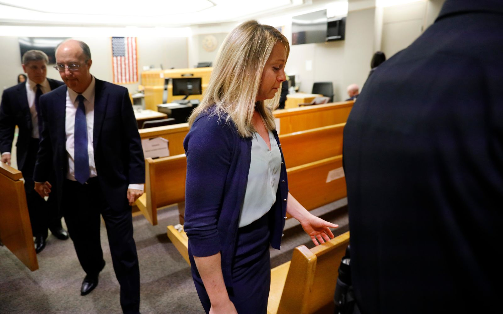 Fired Dallas police officer Amber Guyger leaves the courtroom after a jury found her guilty of murder Tuesday, Oct. 1, 2019, in Dallas. Guyger shot and killed Botham Jean, an unarmed 26-year-old neighbor in his own apartment last year. She told police she thought his apartment was her own and that he was an intruder. (Tom Fox/The Dallas Morning News via AP, Pool)