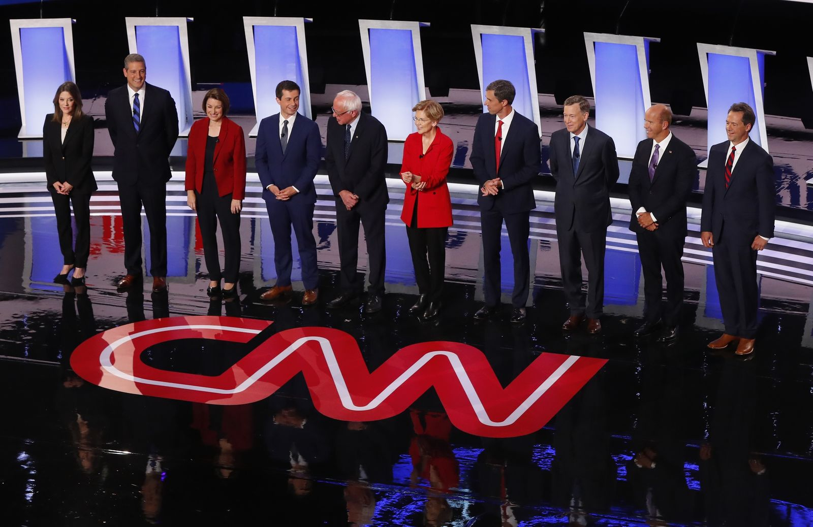 From left, Marianne Williamson, Rep. Tim Ryan, D-Ohio, Sen. Amy Klobuchar, D-Minn., South Bend Mayor Pete Buttigieg, Sen. Bernie Sanders, I-Vt., Sen. Elizabeth Warren, D-Mass., former Texas Rep. Beto O'Rourke, former Colorado Gov. John Hickenlooper, former Maryland Rep. John Delaney and Montana Gov. Steve Bullock take the stage for the first of two Democratic presidential primary debates hosted by CNN Tuesday, July 30, 2019, in the Fox Theatre in Detroit. (AP Photo/Paul Sancya)