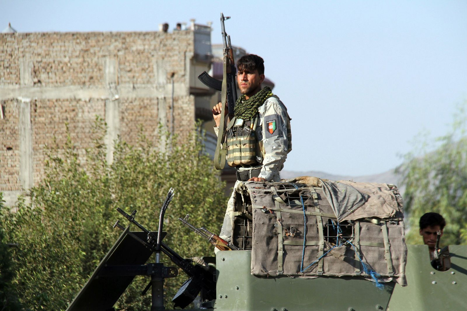 Afghan security forces arrive near the site of a suicide bombing and gun battle as militants attempted to storm a government office, in Jalalabad, the provincial capital of eastern Afghanistan, Wednesday, Sept. 18, 2019. The violence comes as Afghanistan prepares for presidential elections on Sept. 28, a vote the Taliban vehemently oppose. (AP Photo)wld